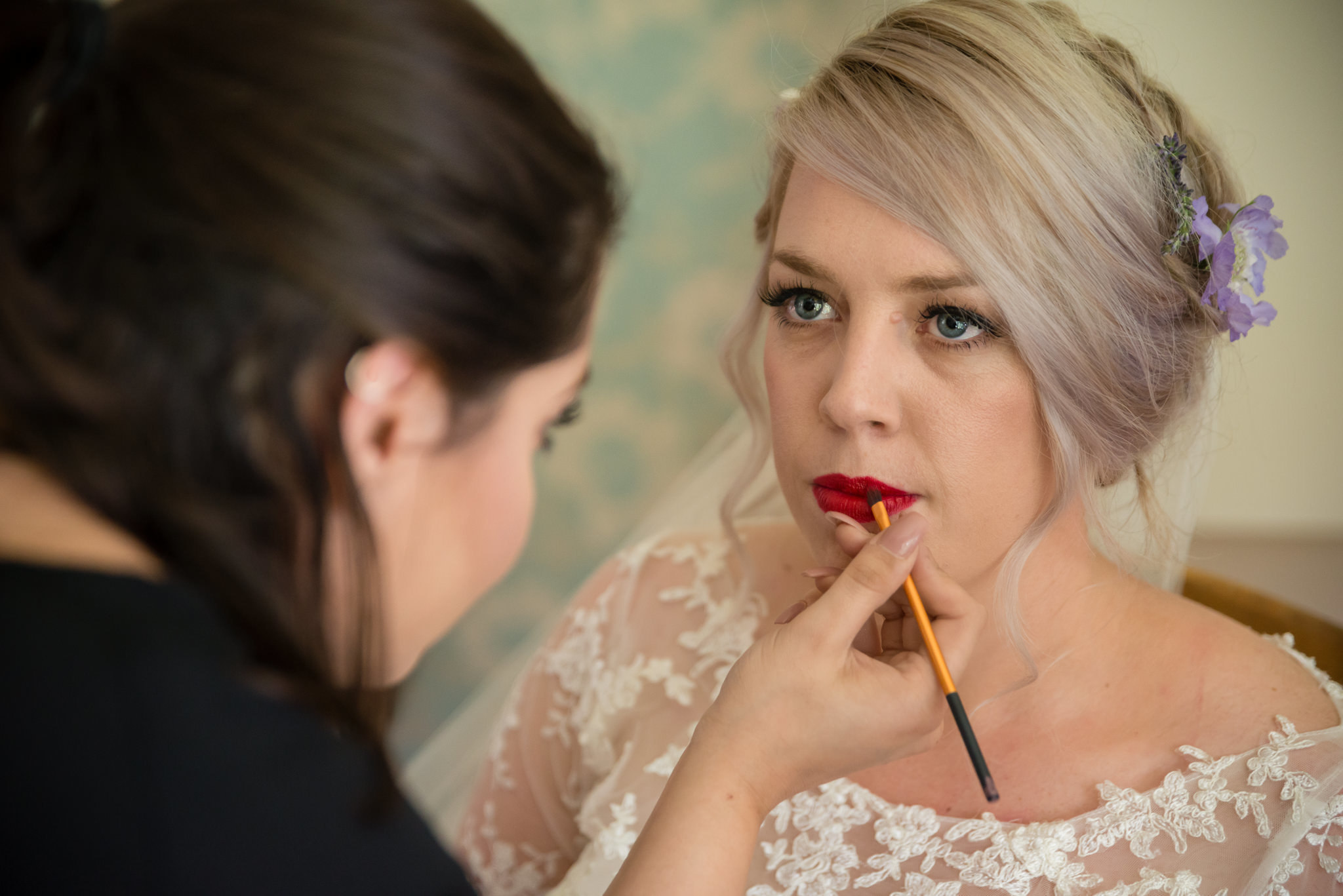 The bride has her makeup done
