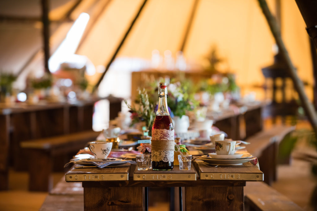 Table decorations for a tipi wedding