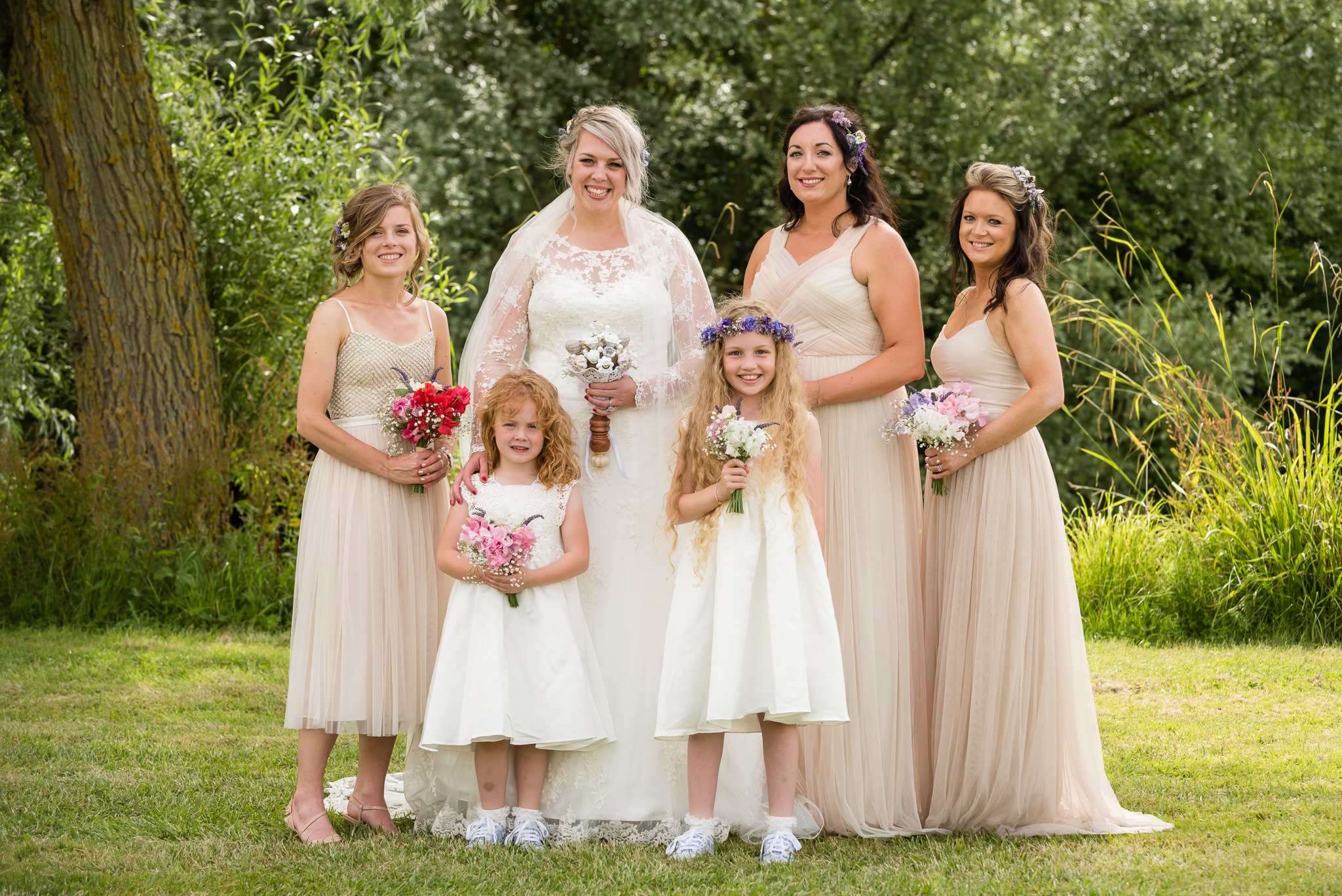 The bride and her bridesmaids and her flower girls