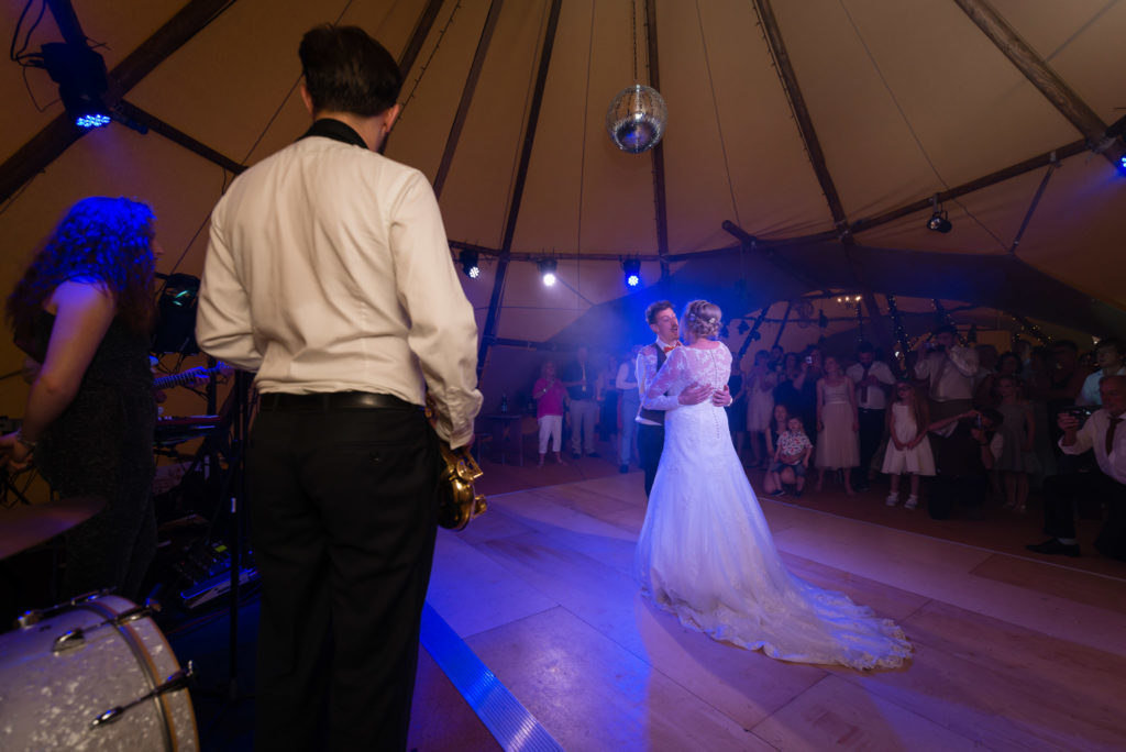 The bride and groom's first dance in the wedding tipi
