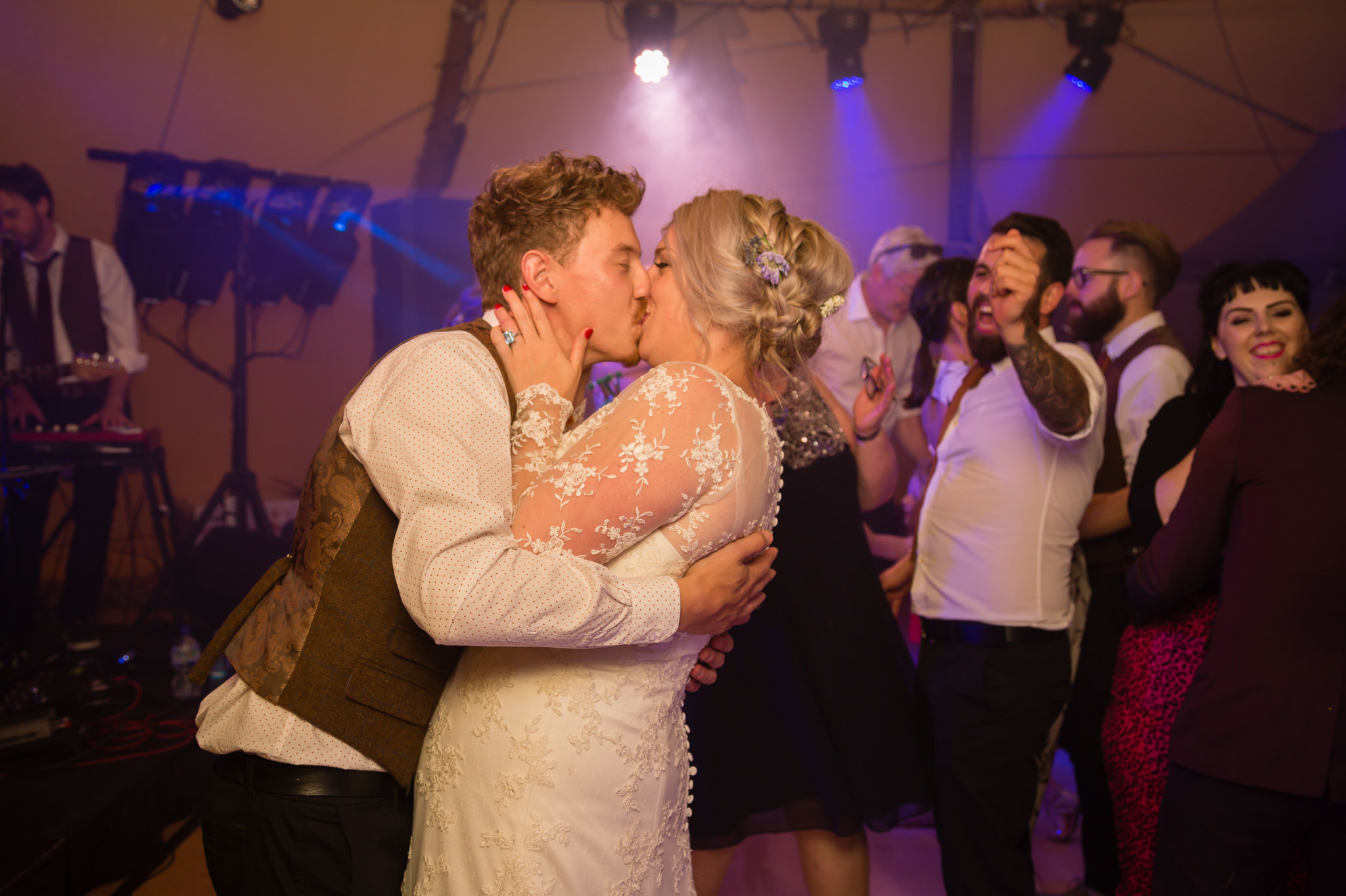 The bride and groom kiss during the first dance