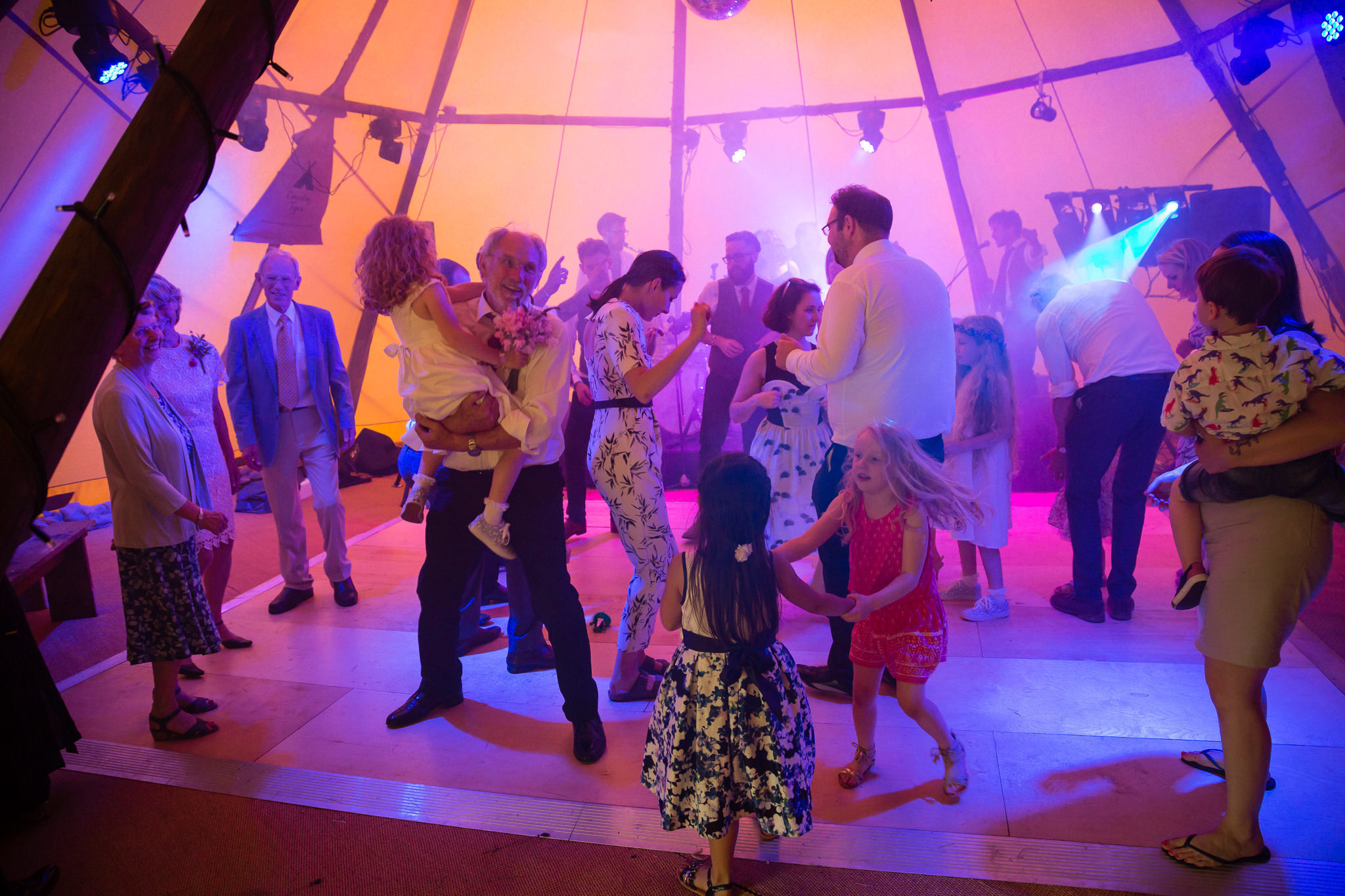 Wedding guests dancing in the tipi