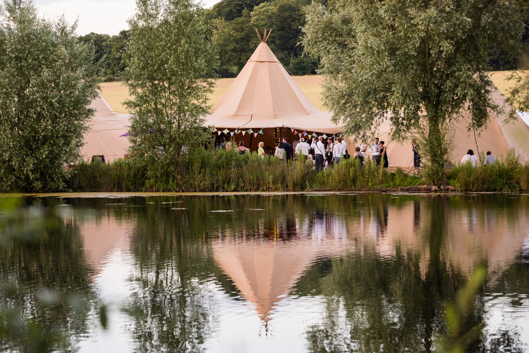 A reflection of the tipi in the lake