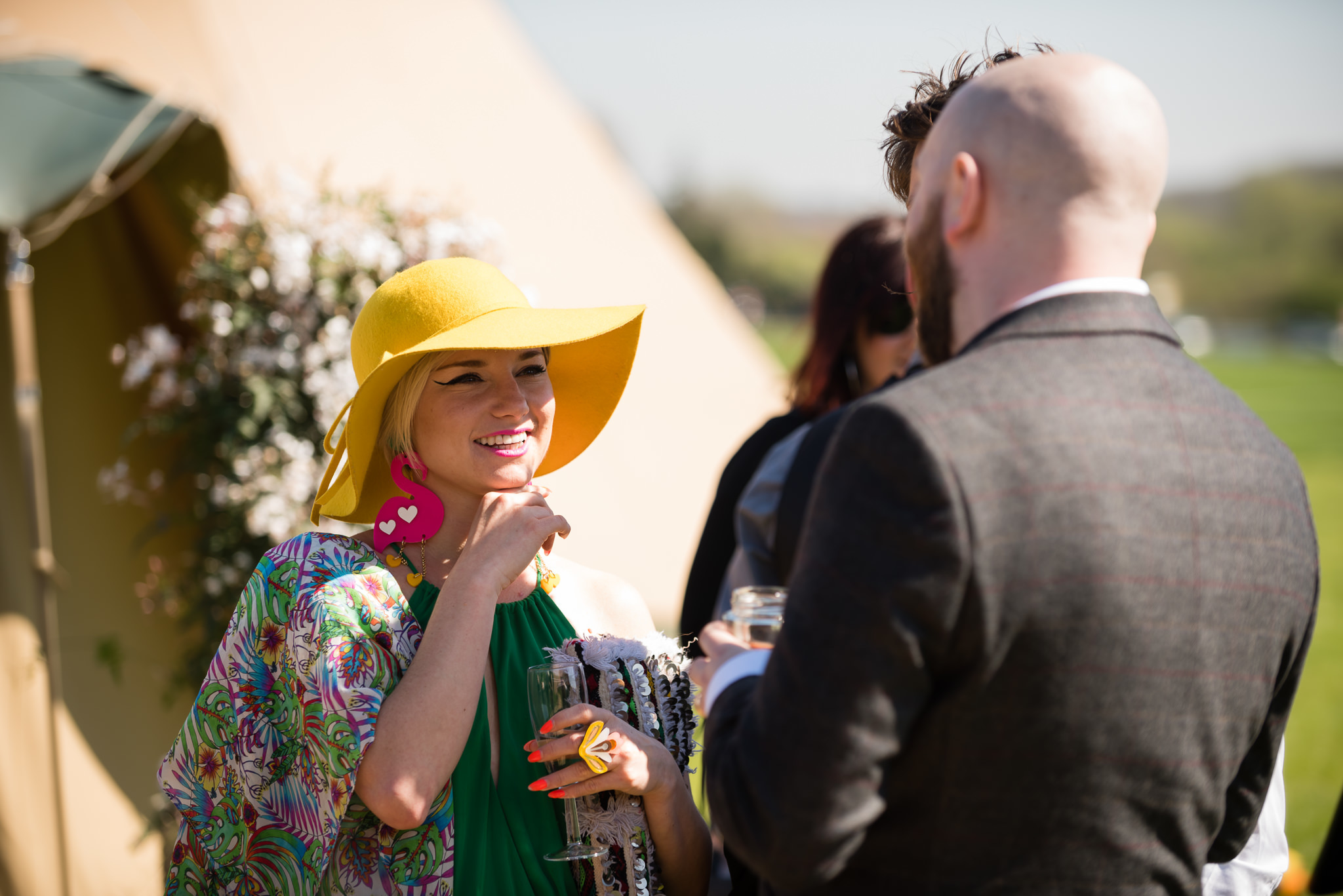 Wedding guests talking with each other outside the teepee