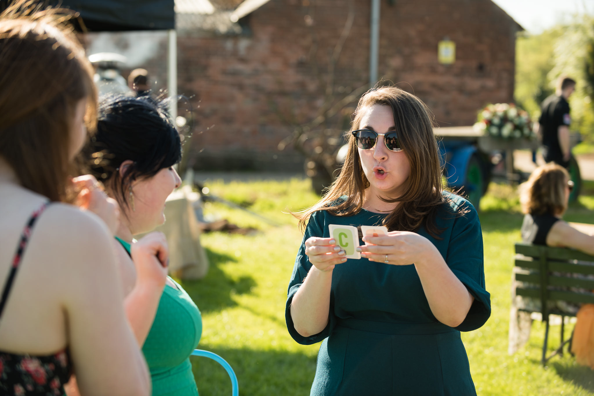 Wedding guests playing cards against humanity