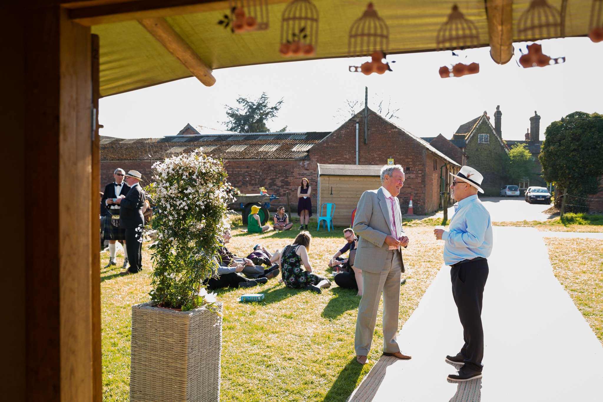 Guests enjoying a sunny day outside the tipi