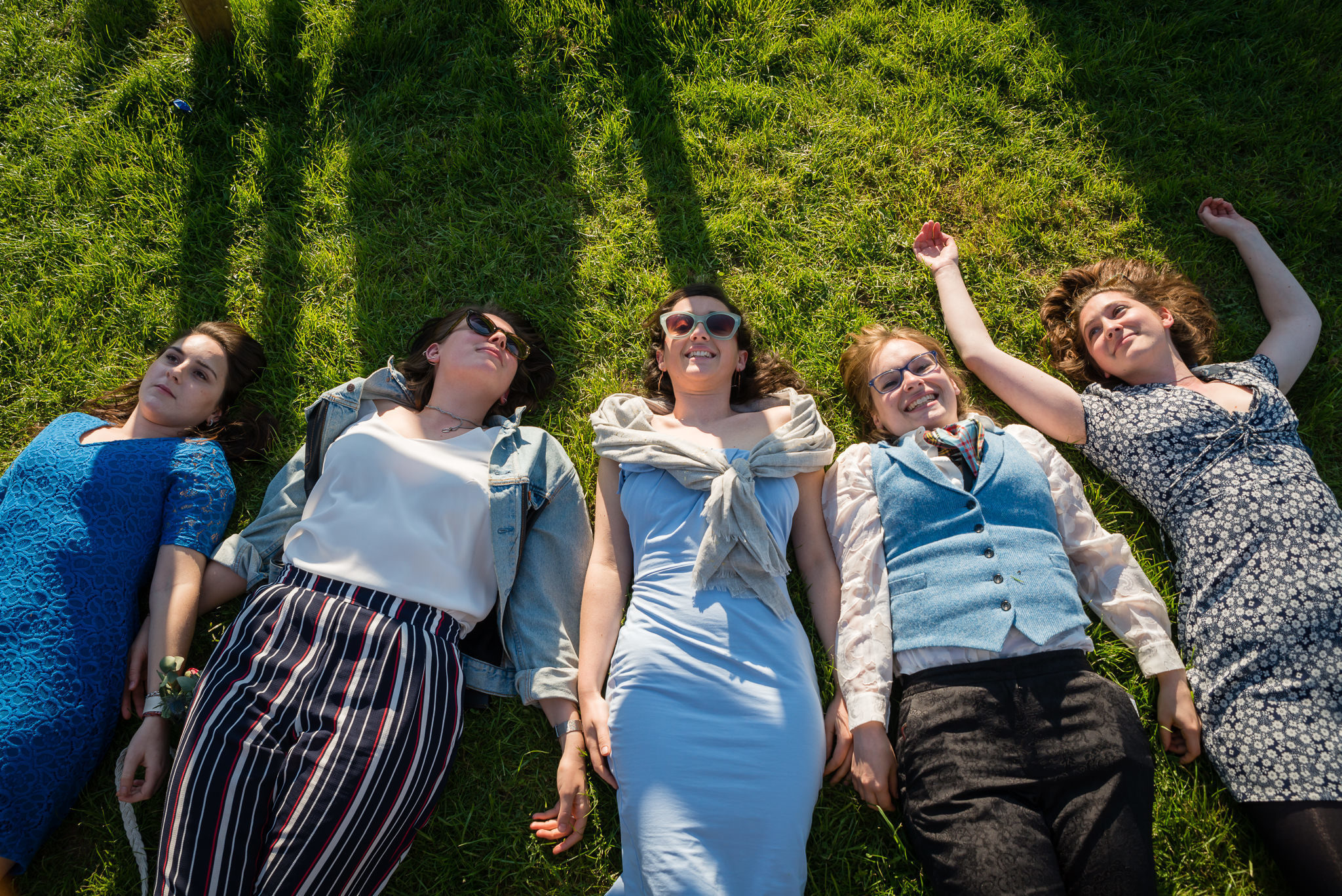 The Bride lying on the grass with her friends