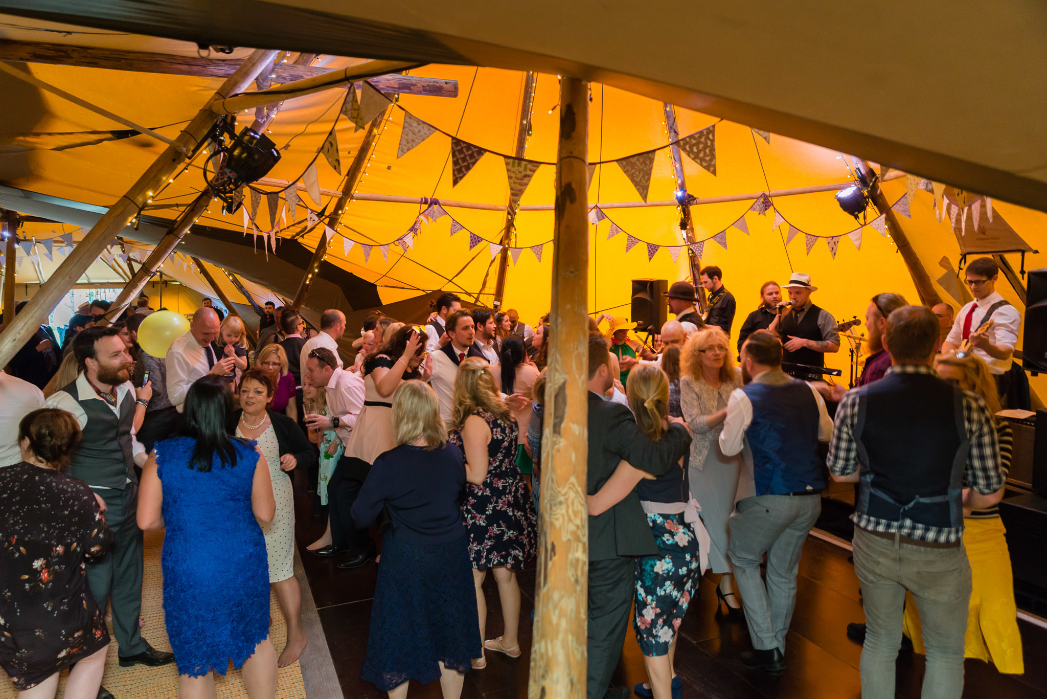 A packed dance floor during the tipi wedding