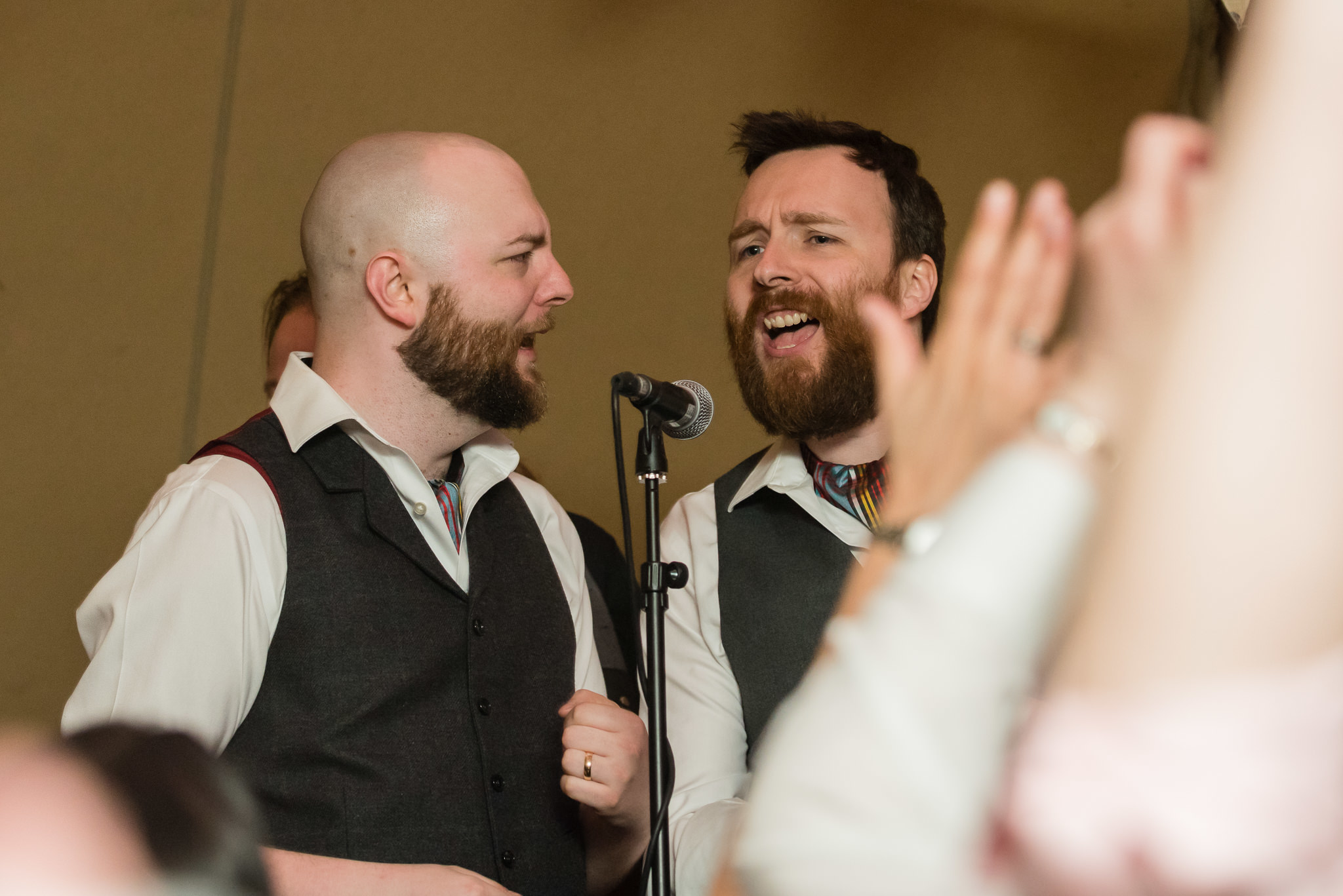 The groom and his brother perform during the tipi wedding reception