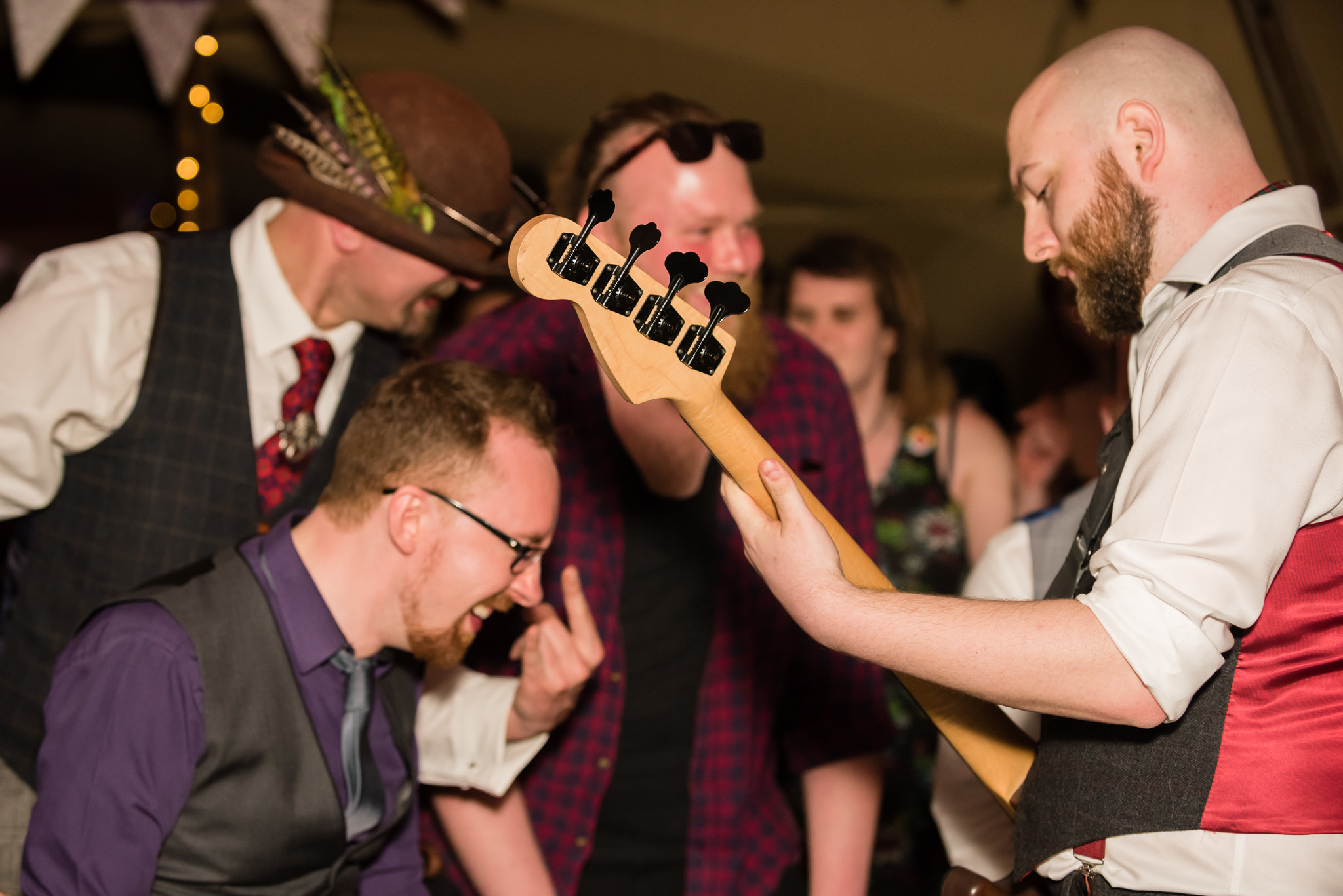 The groom on the guitar during his tipi wedding reception