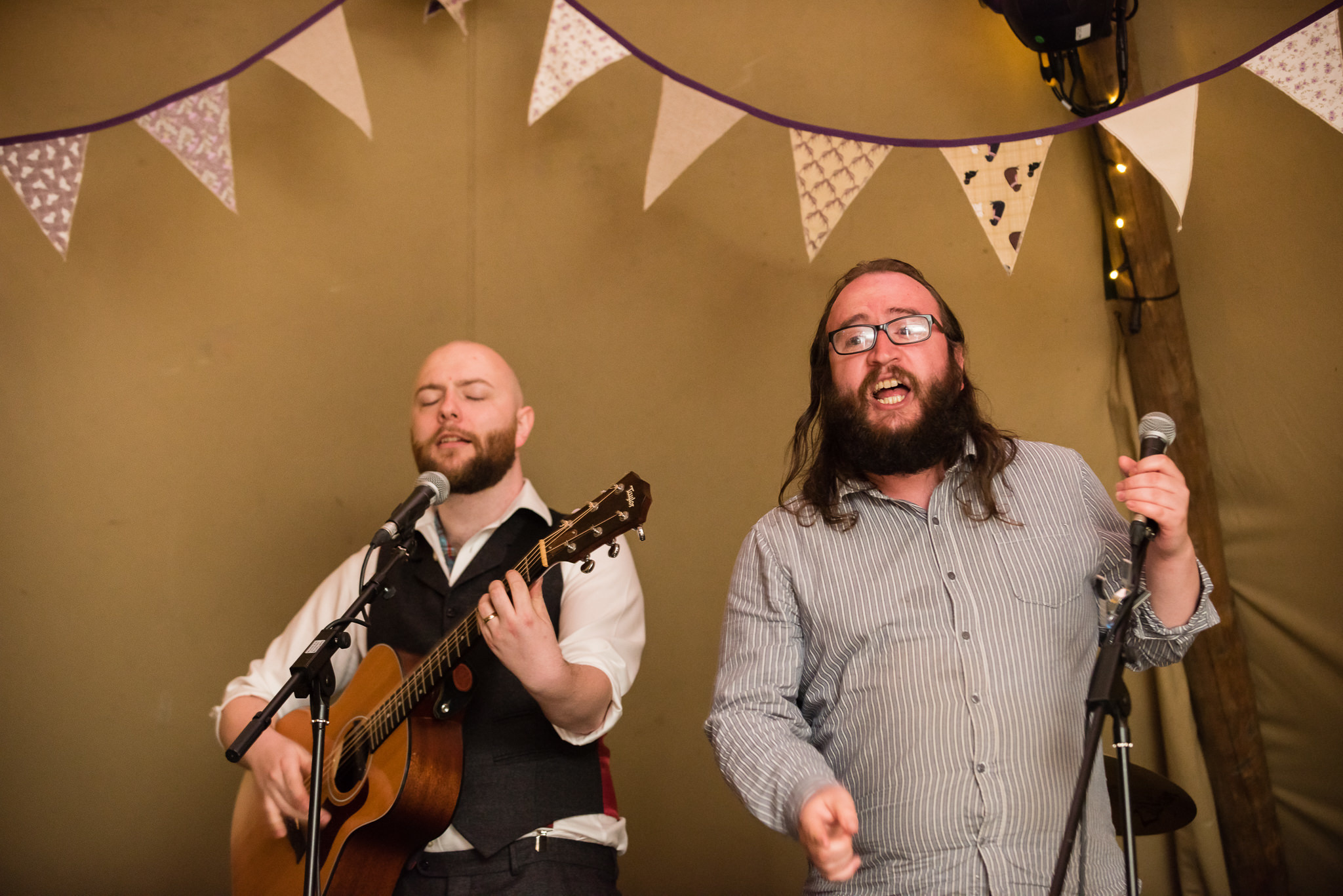 The groom and his friend perform during the tipi wedding reception