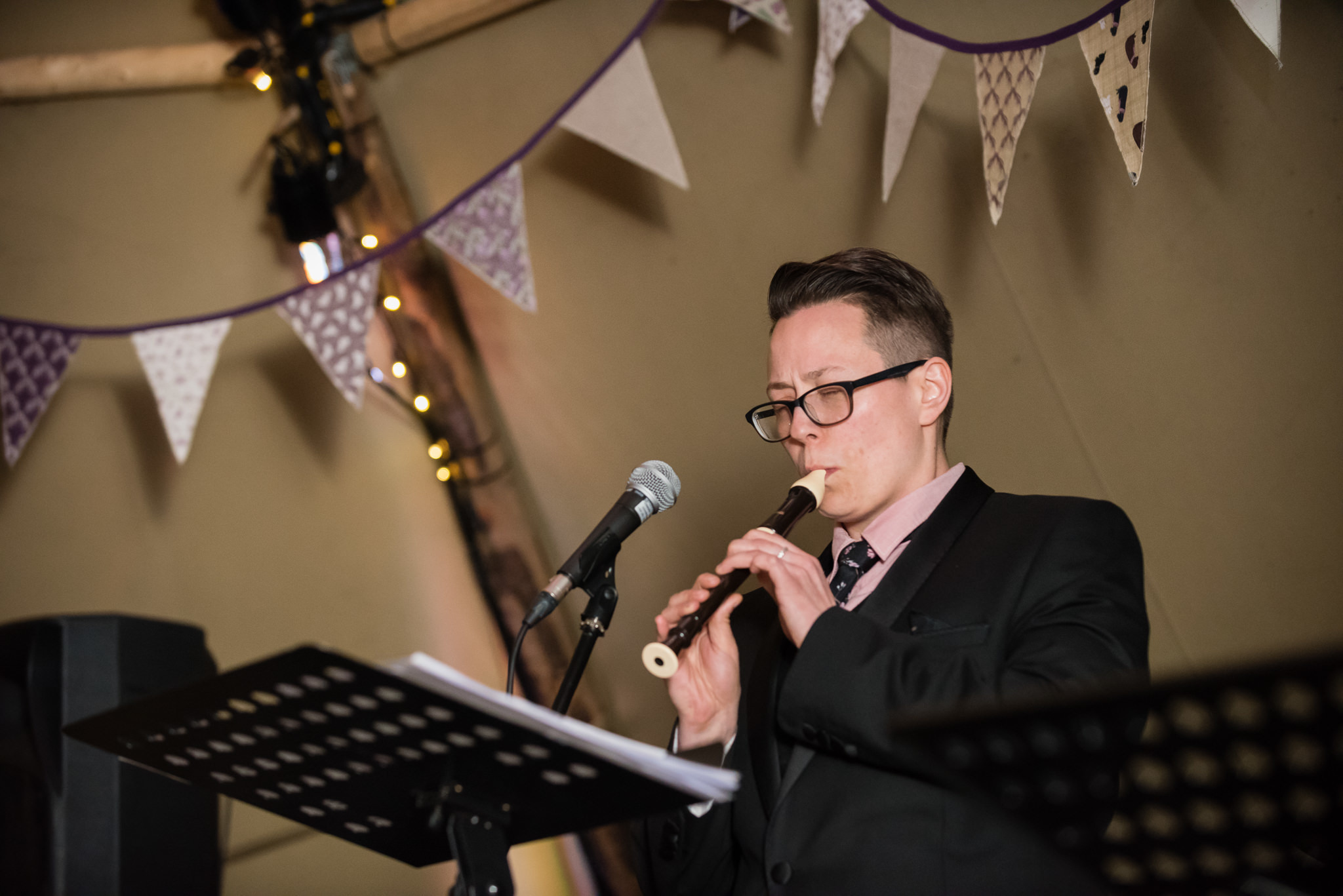 Guests perform at the wedding reception