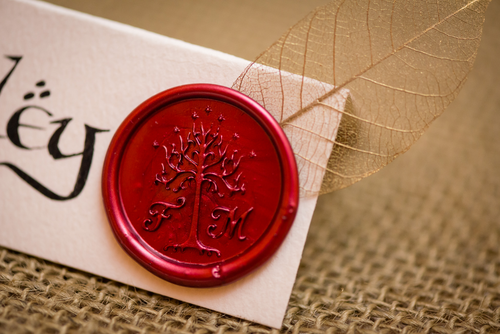A detail shot of the wax seal on the name place settings