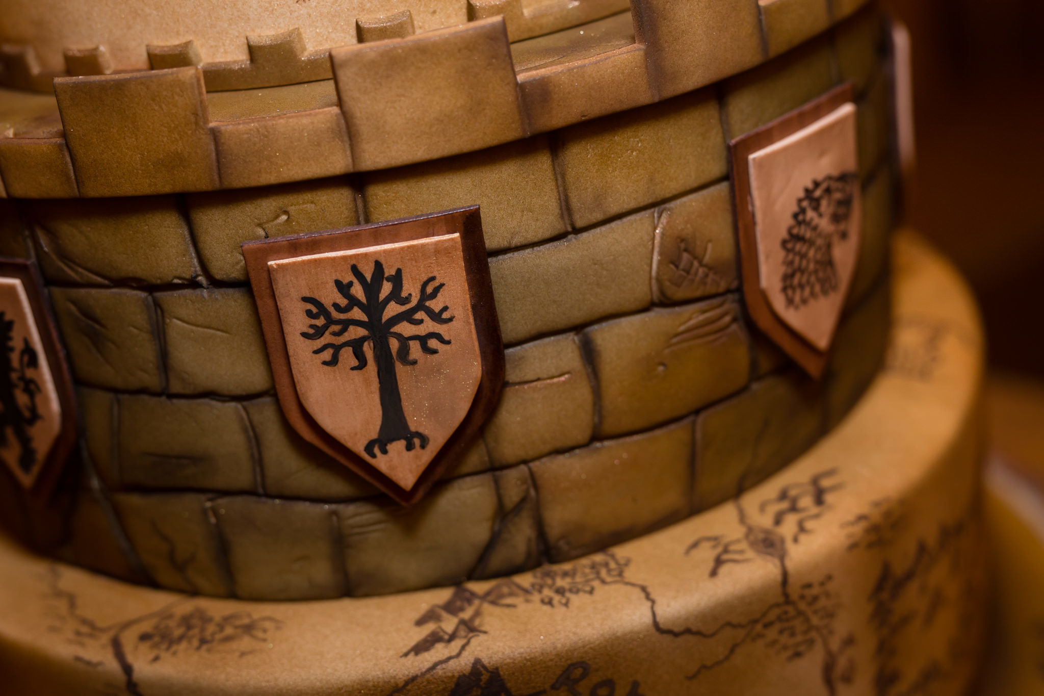 A detail shot of The Lord of the Rings themed wedding cake