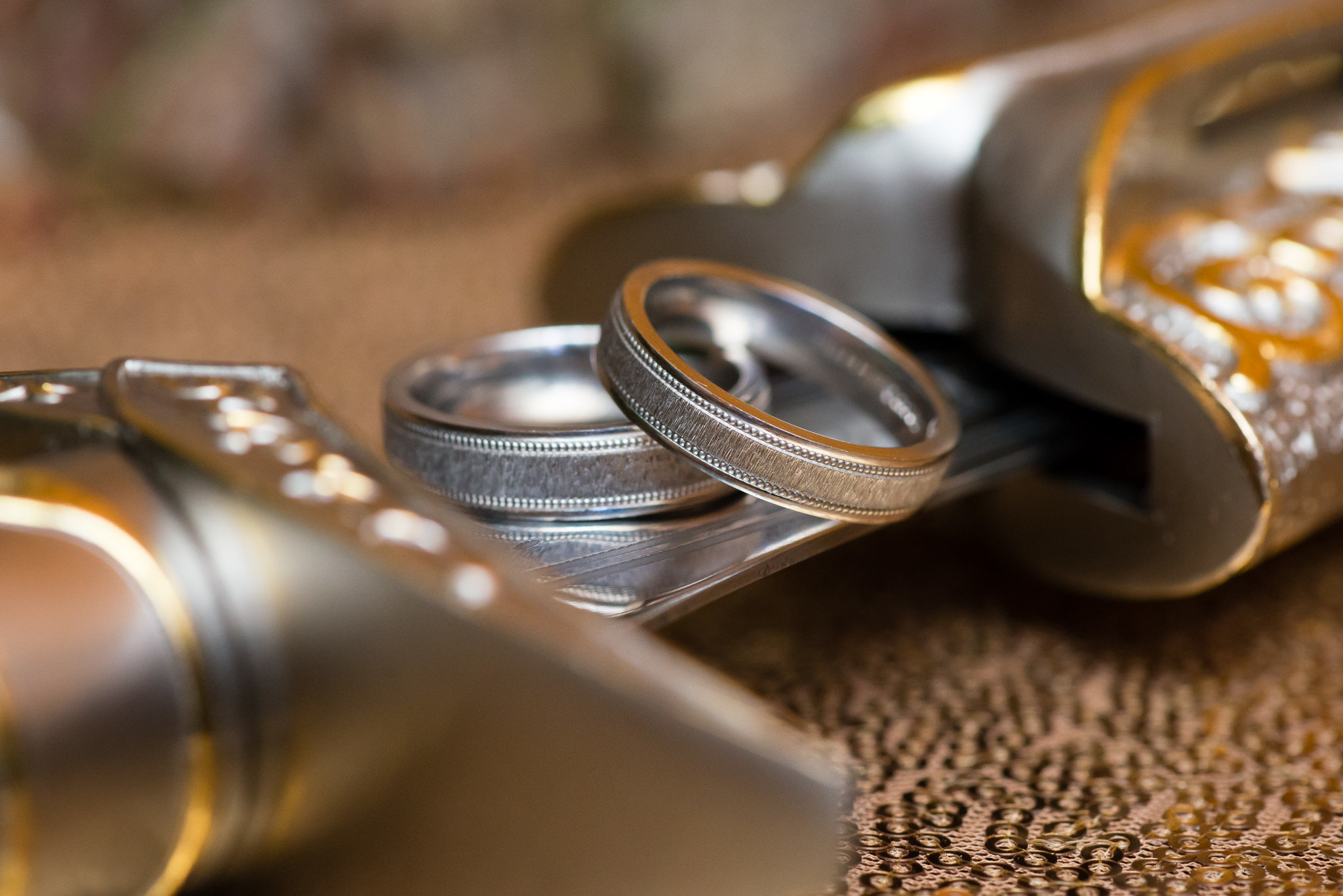 The bride and groom's wedding rings pictured on a sword