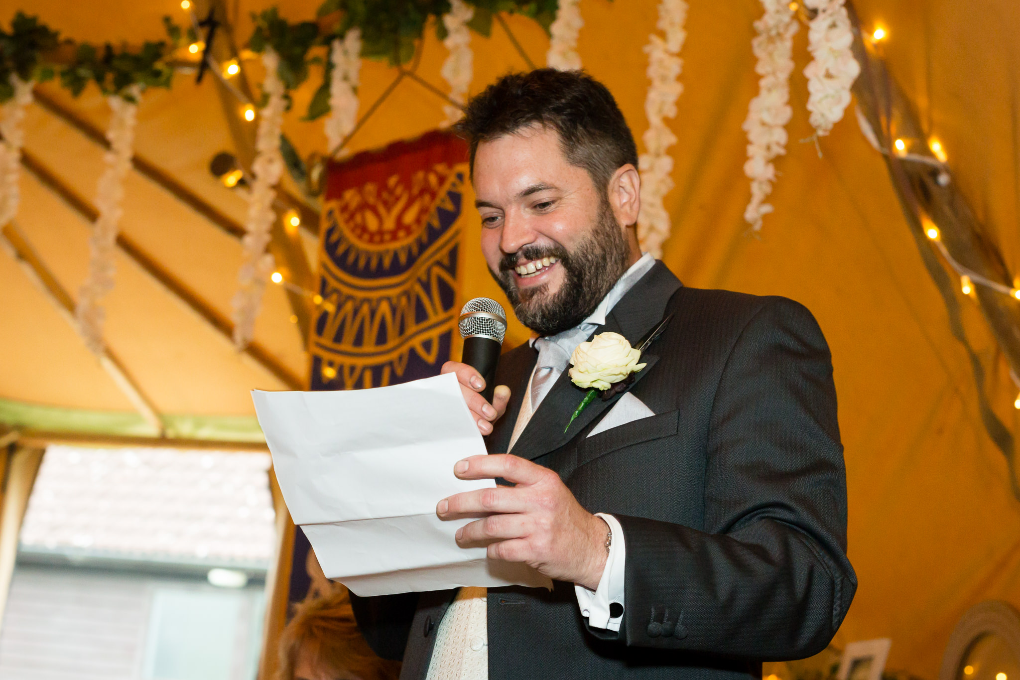 The best man giving his speech during the tipi wedding reception