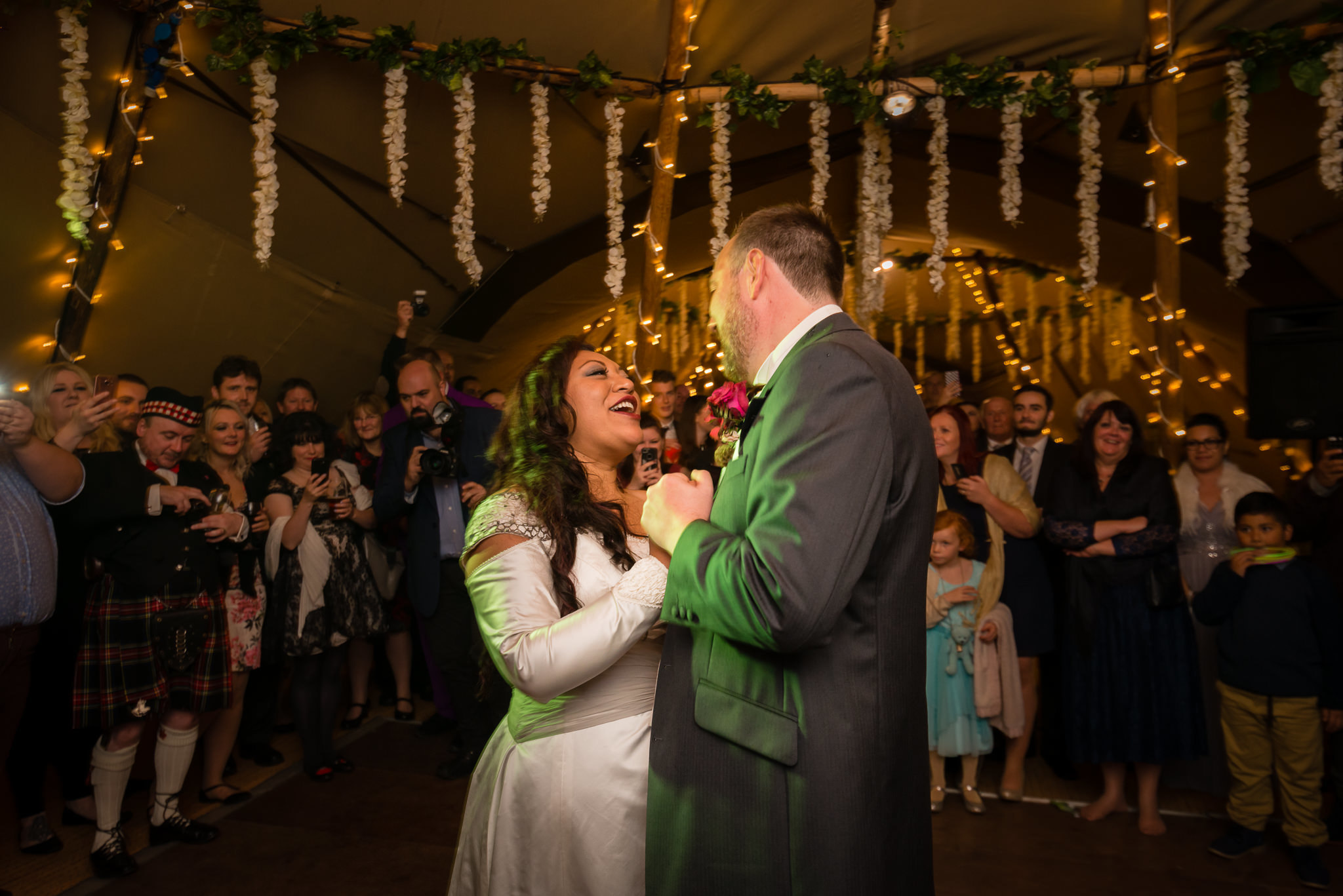 The bride and groom's first dance at their tipi wedding