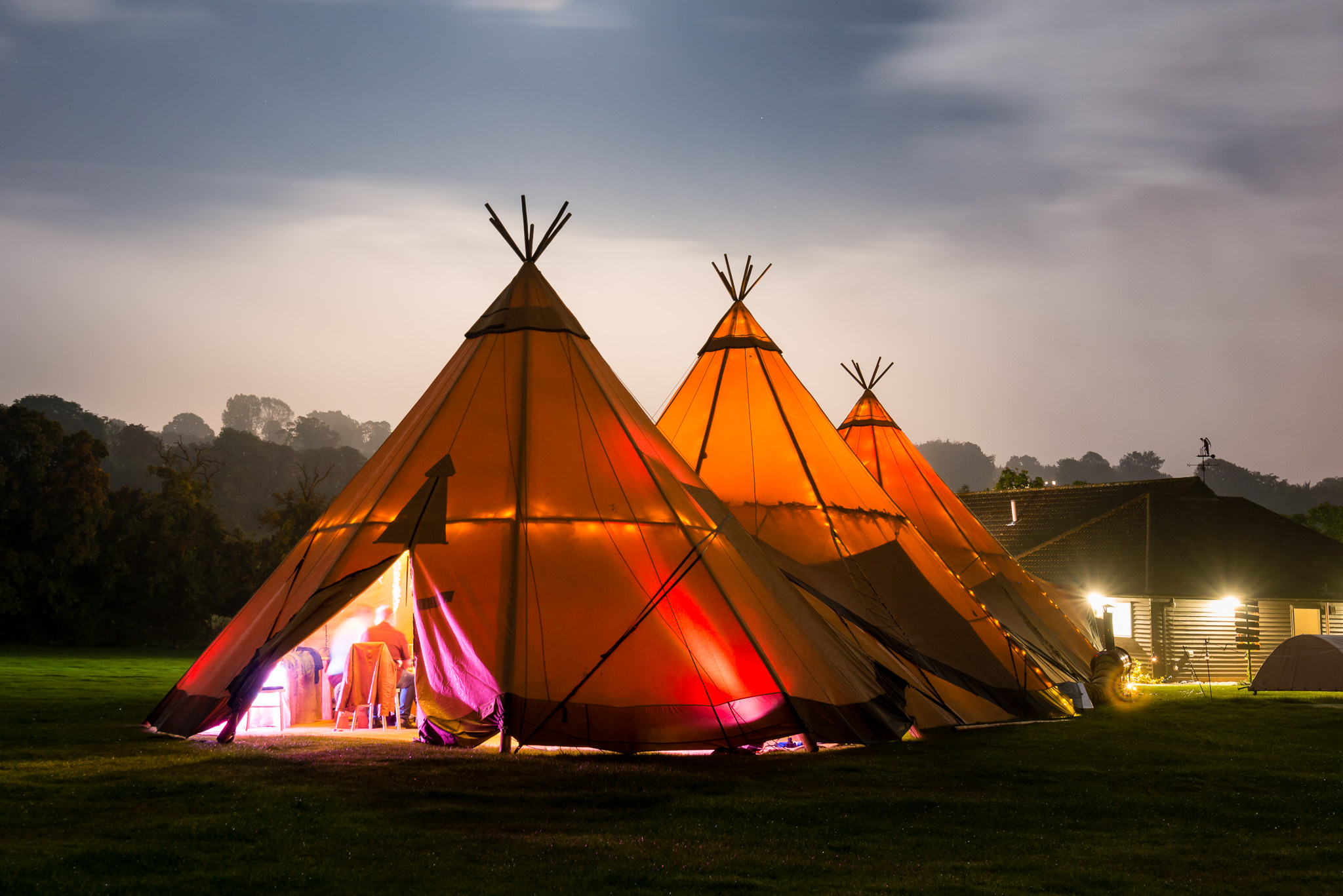 The tipis at night-time