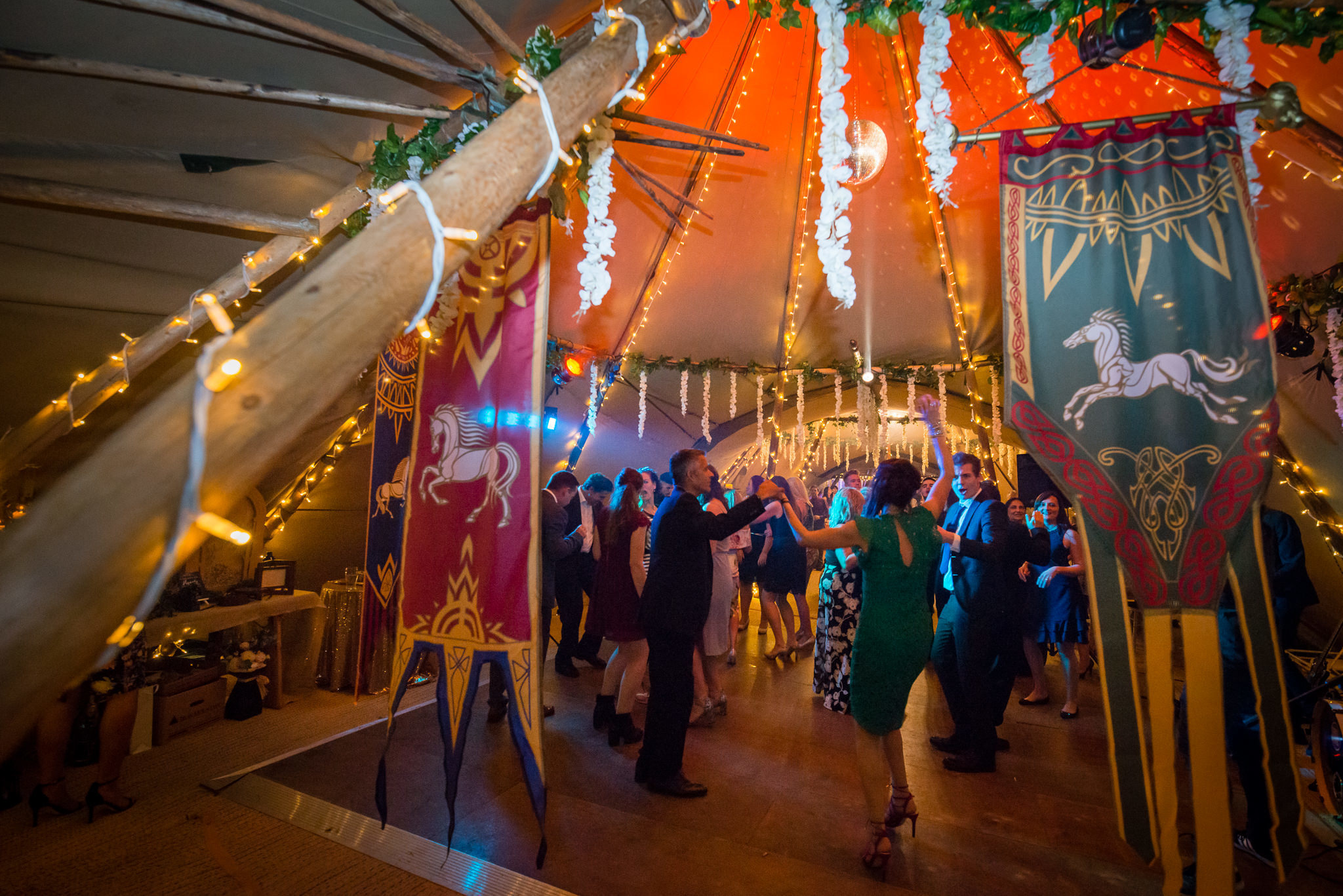 Guests dancing in at the tipi wedding