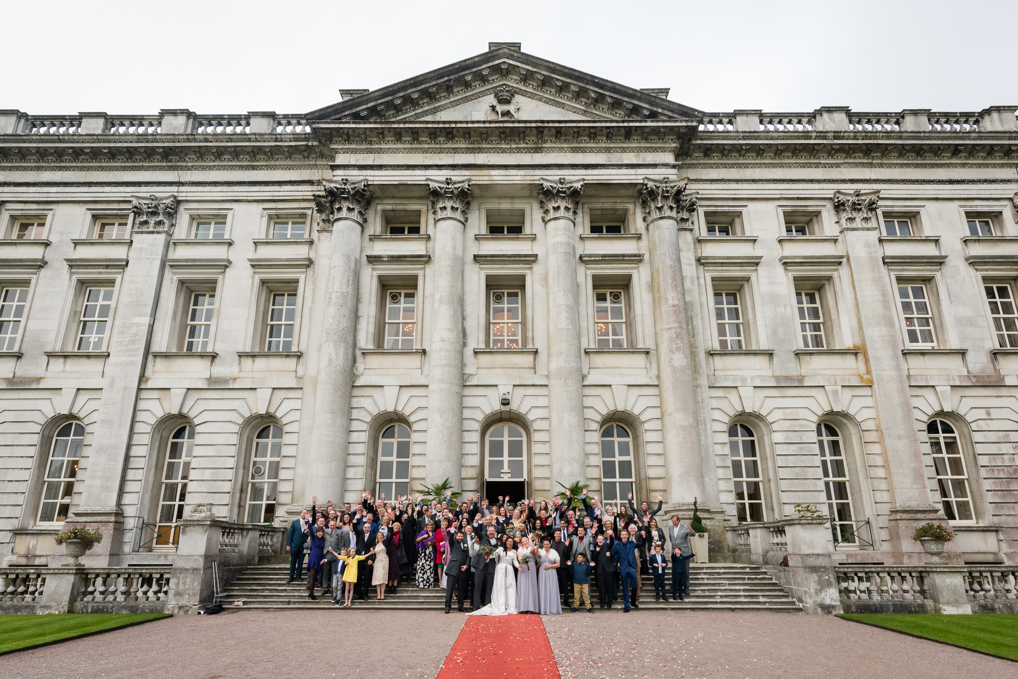 A group shot of all of the wedding guests outside Moor Park