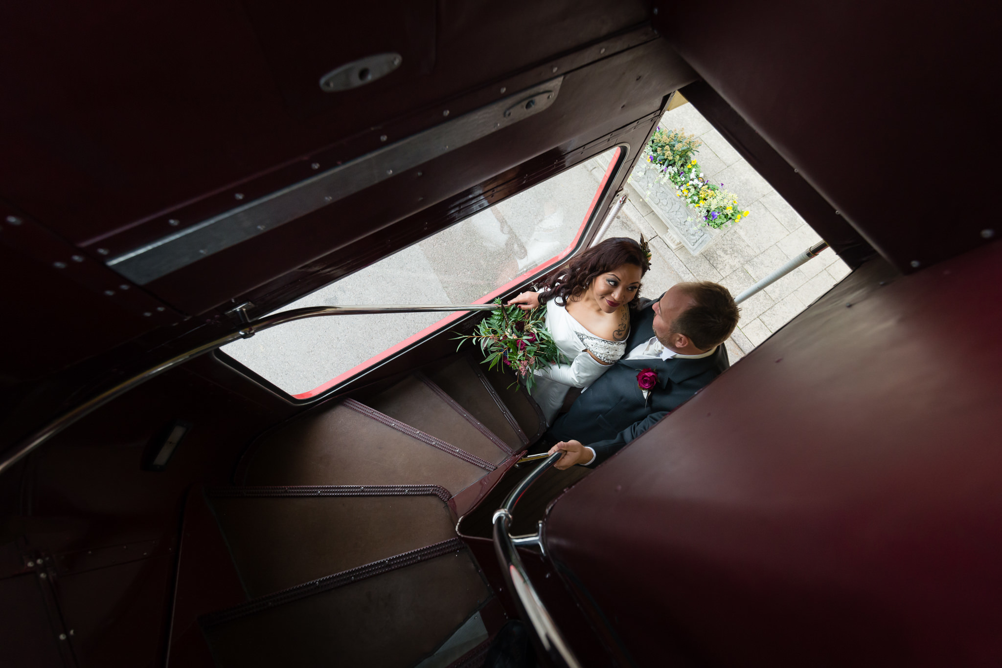 A portrait of the bride and groom on their wedding bus at Moor Park