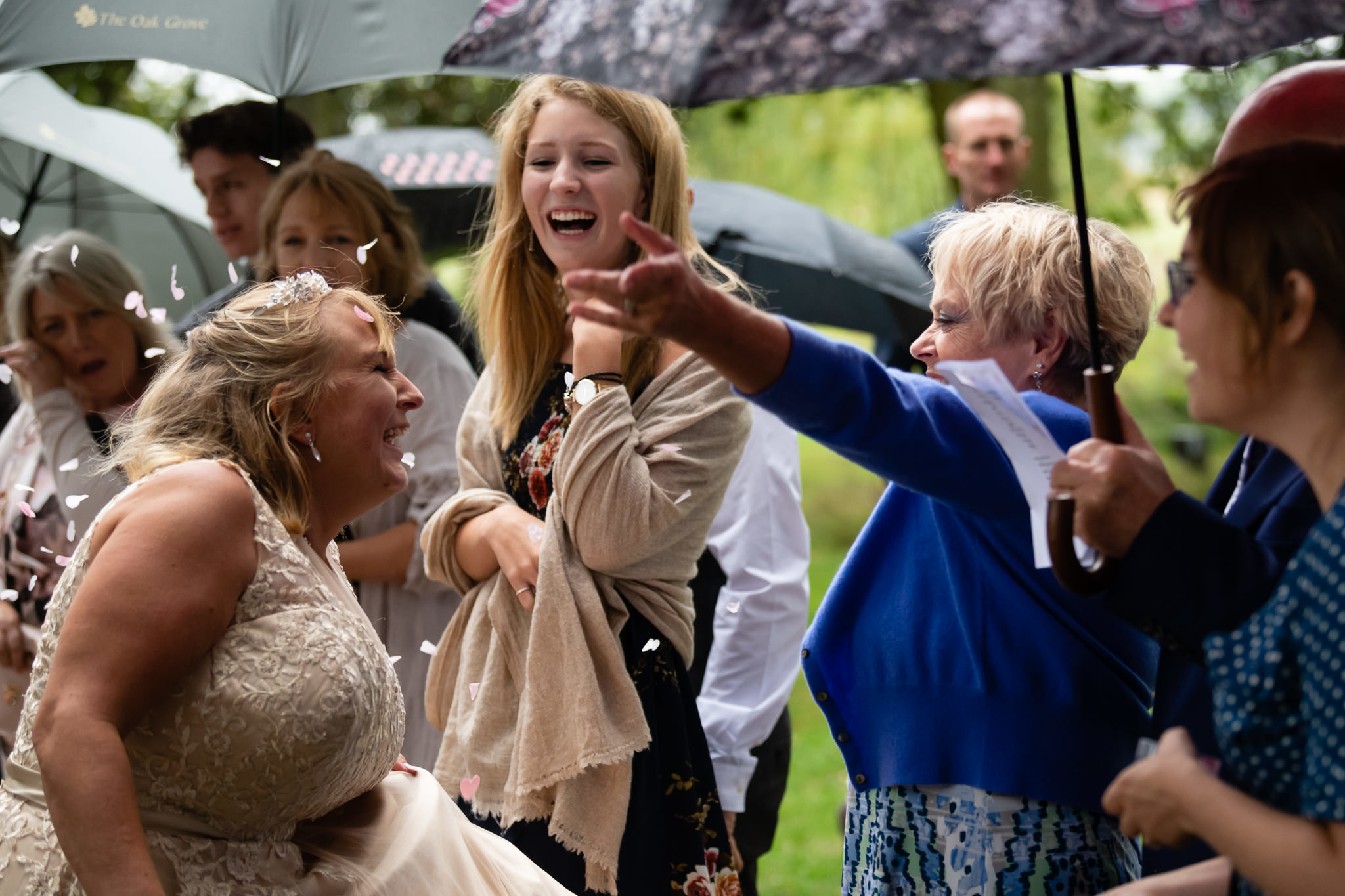 Wedding guest throws confetti on the Bride
