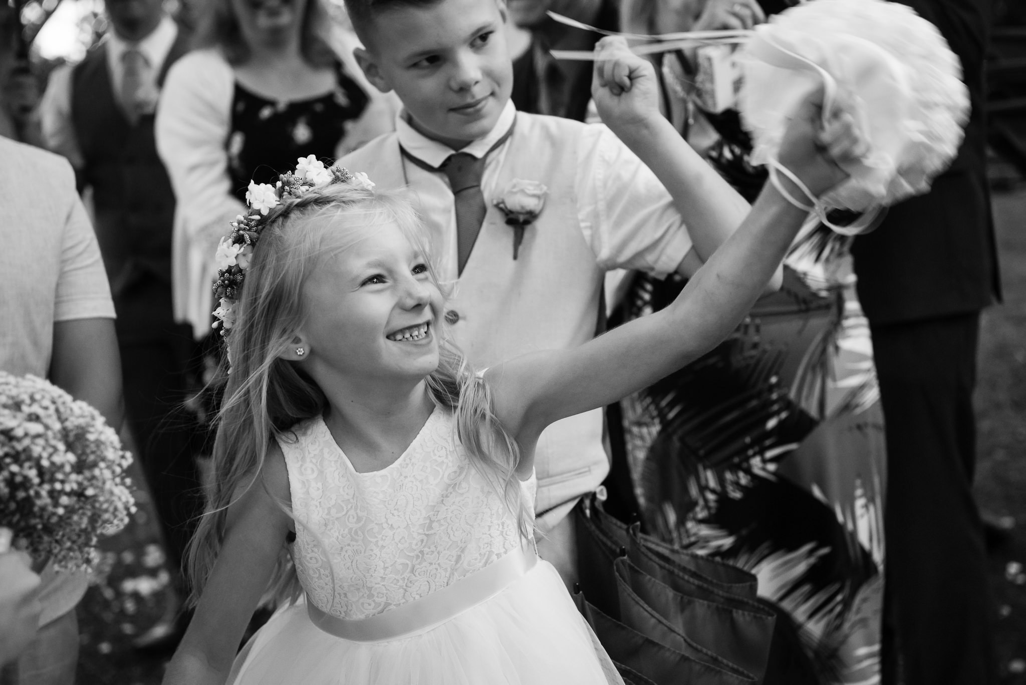 A flower girl throwing confetti