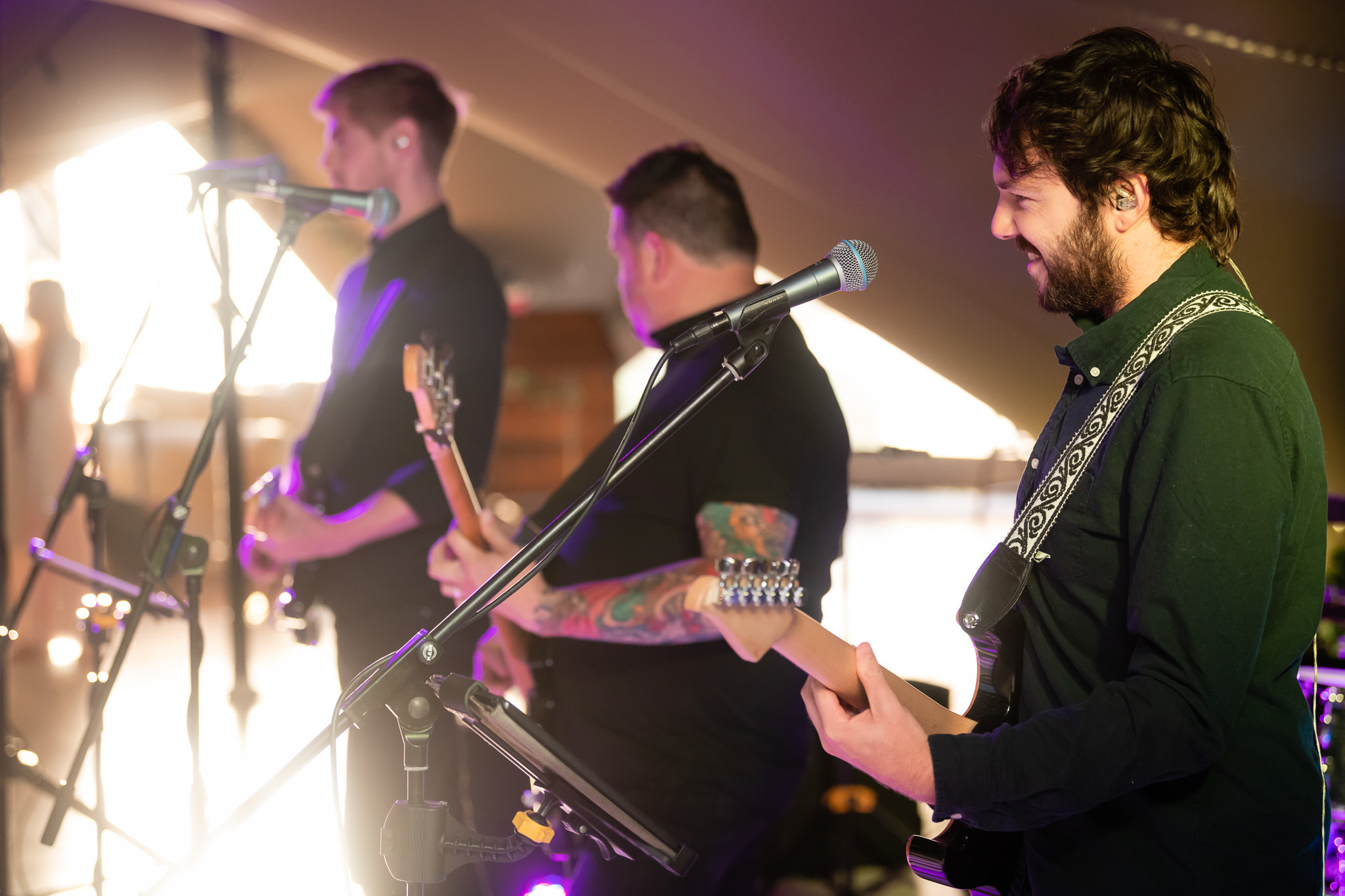 The band performing in the stretched tent