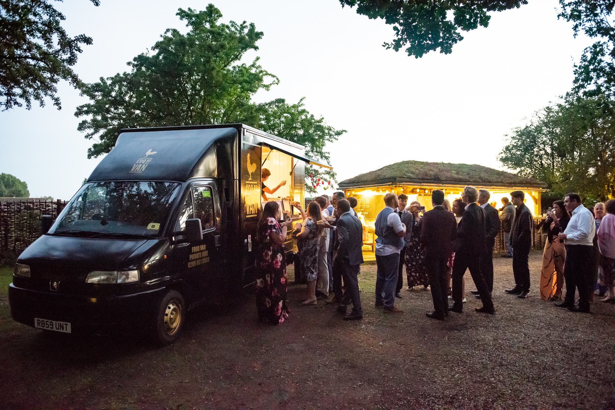 Guests queue at a food van