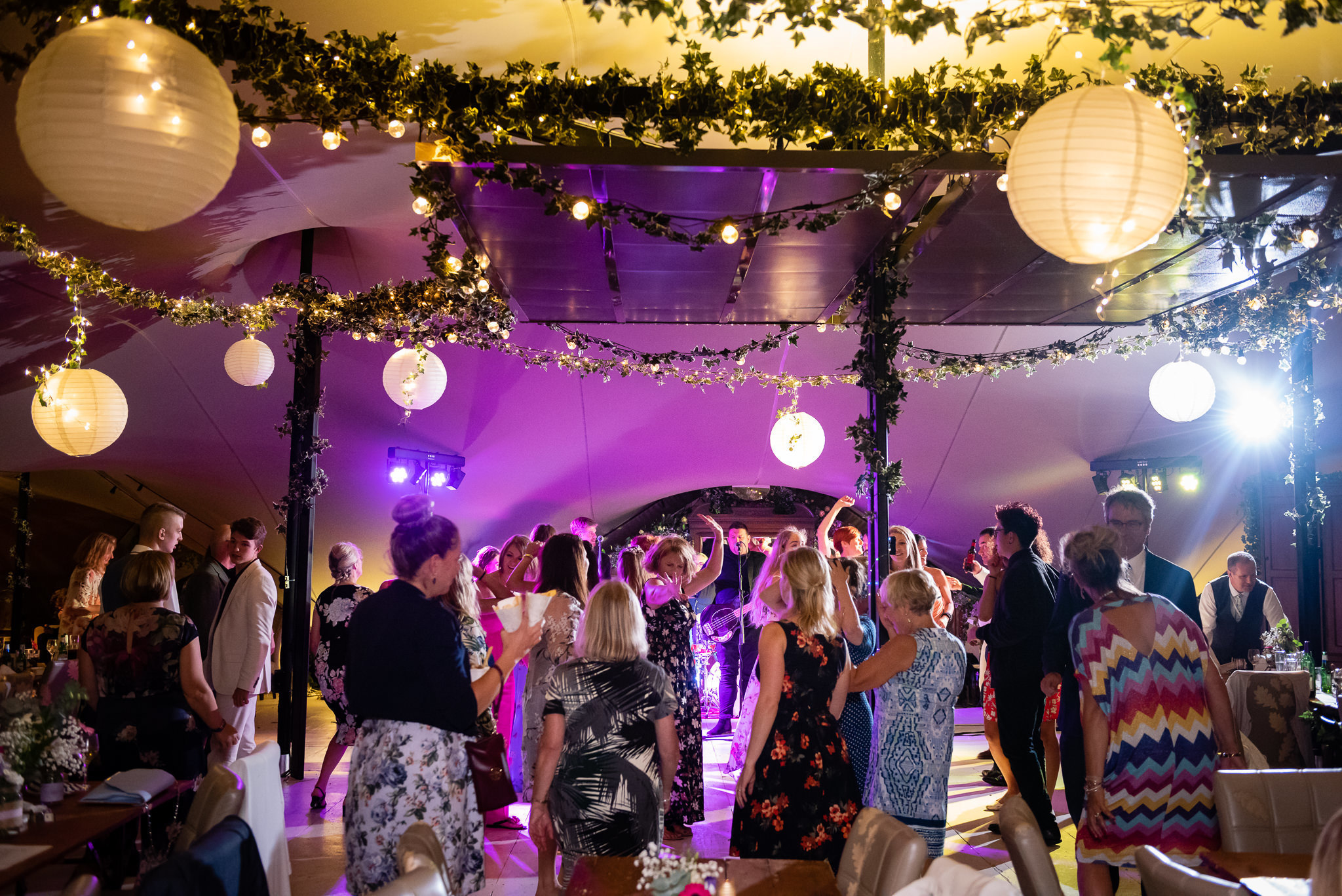 Wedding guests dance in the stretch tent at The Oak Grove