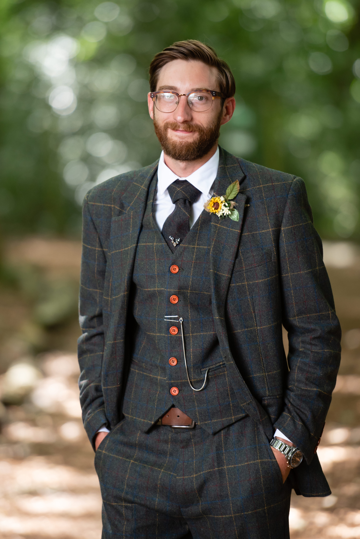 A portrait of the groom before his woodland wedding