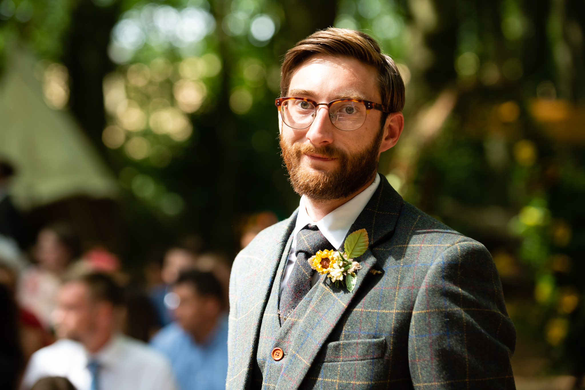 A portrait of the groom before his outdoor wedding