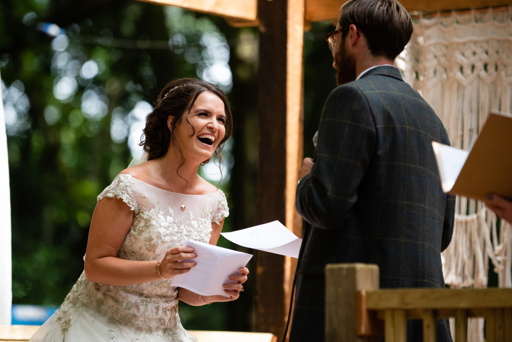 The Bride laughs during her wedding vows