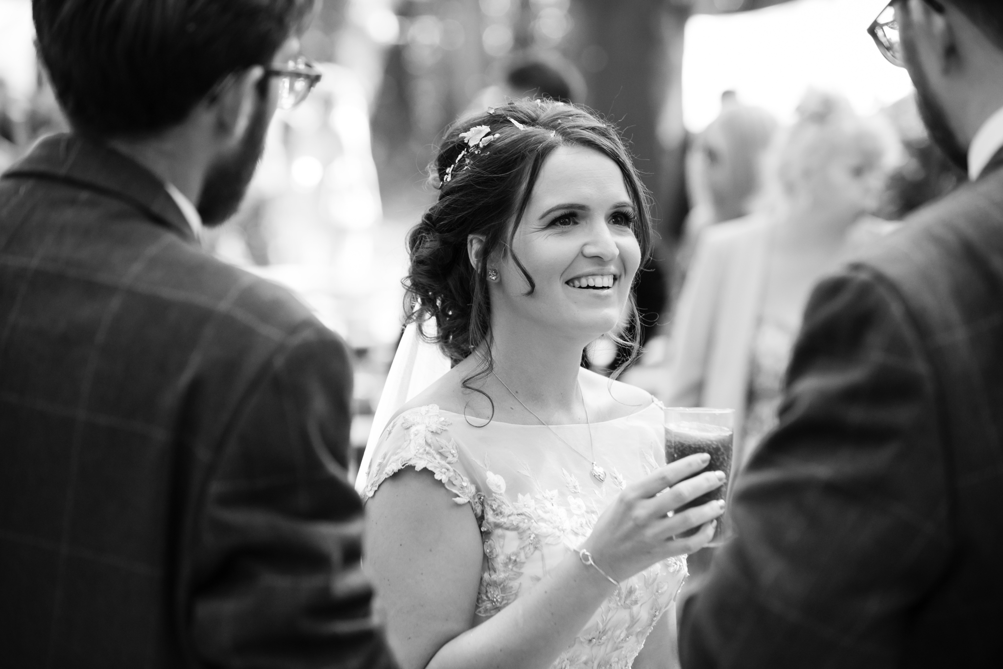 The bride has a drink after the wedding ceremony