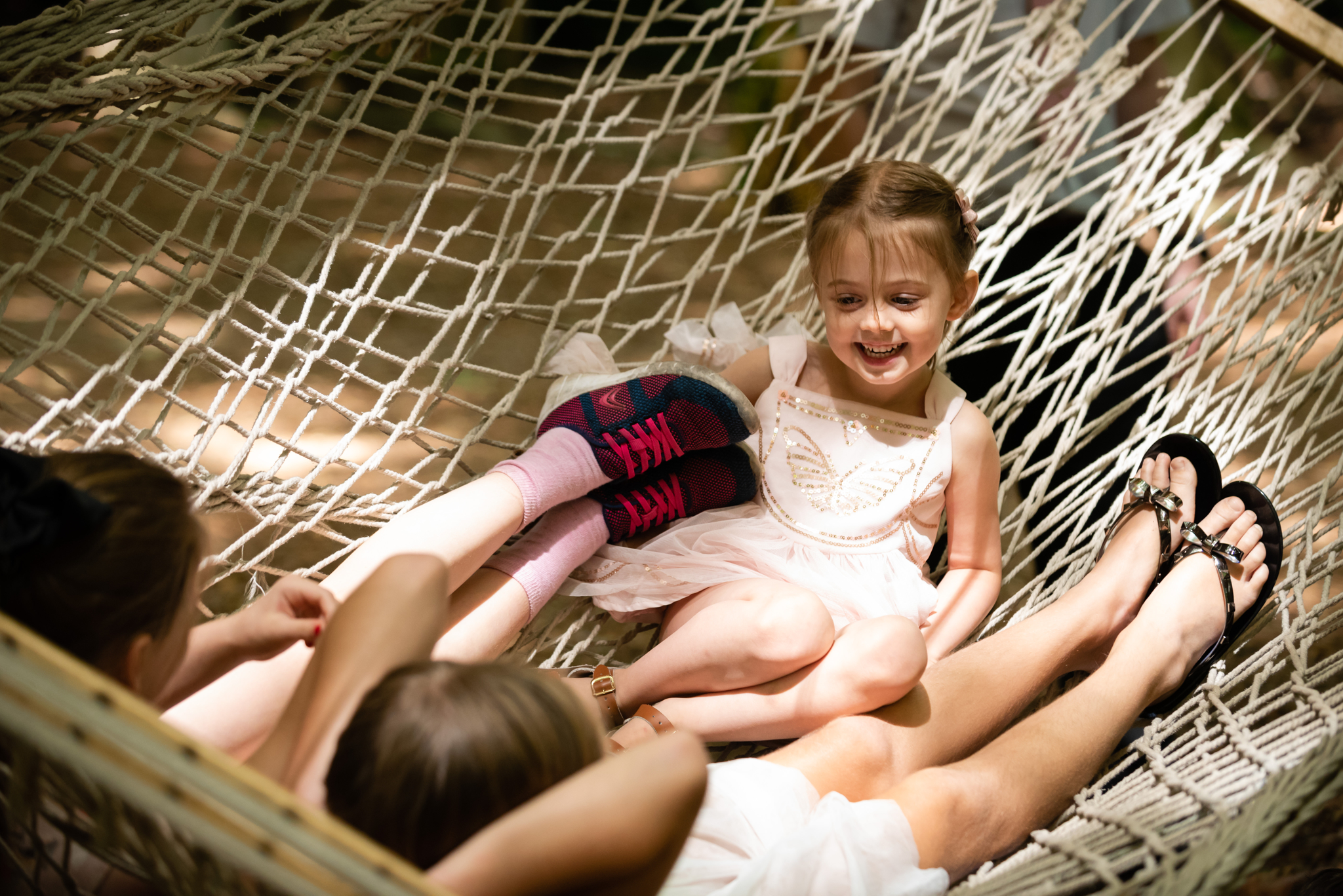 Kids playing in a hammock