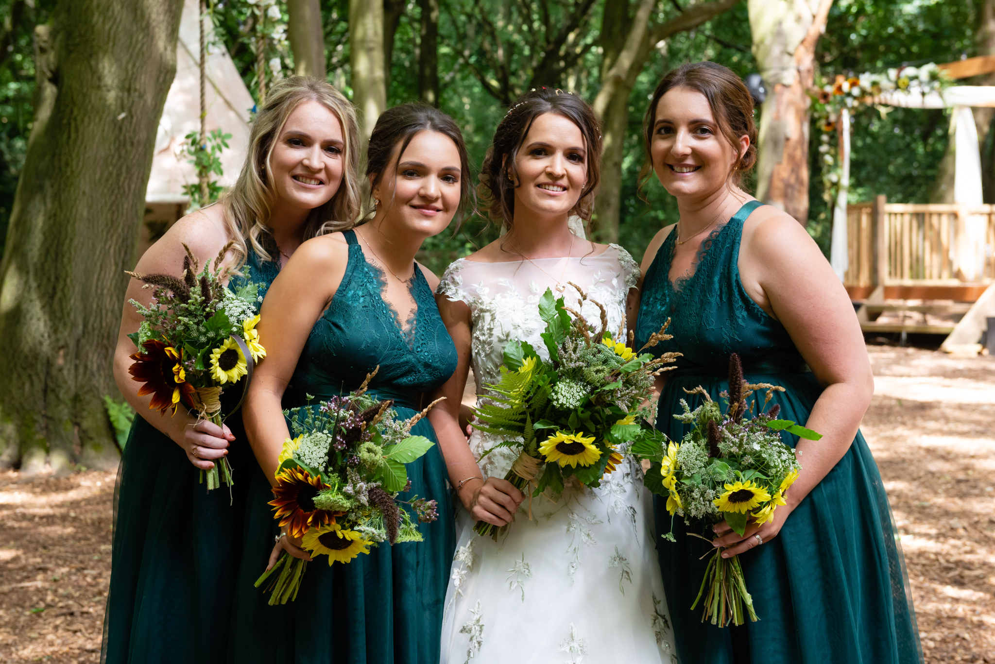 The bride and her bridesmaids at her woodland wedding