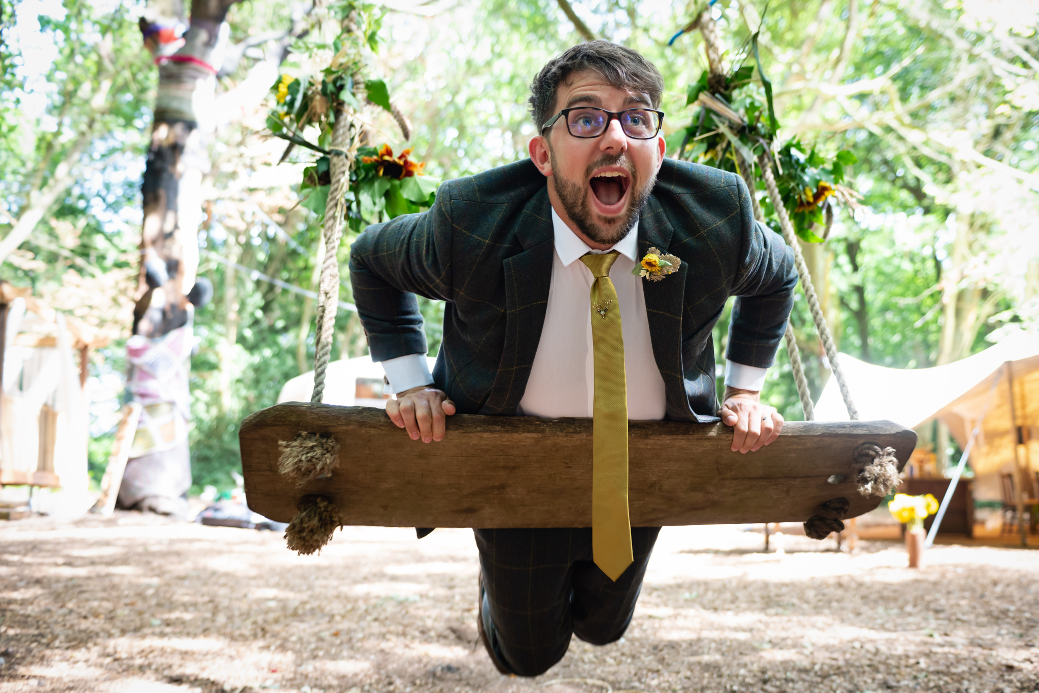 An Usher plays on the swing at woodland Weddings in Tring