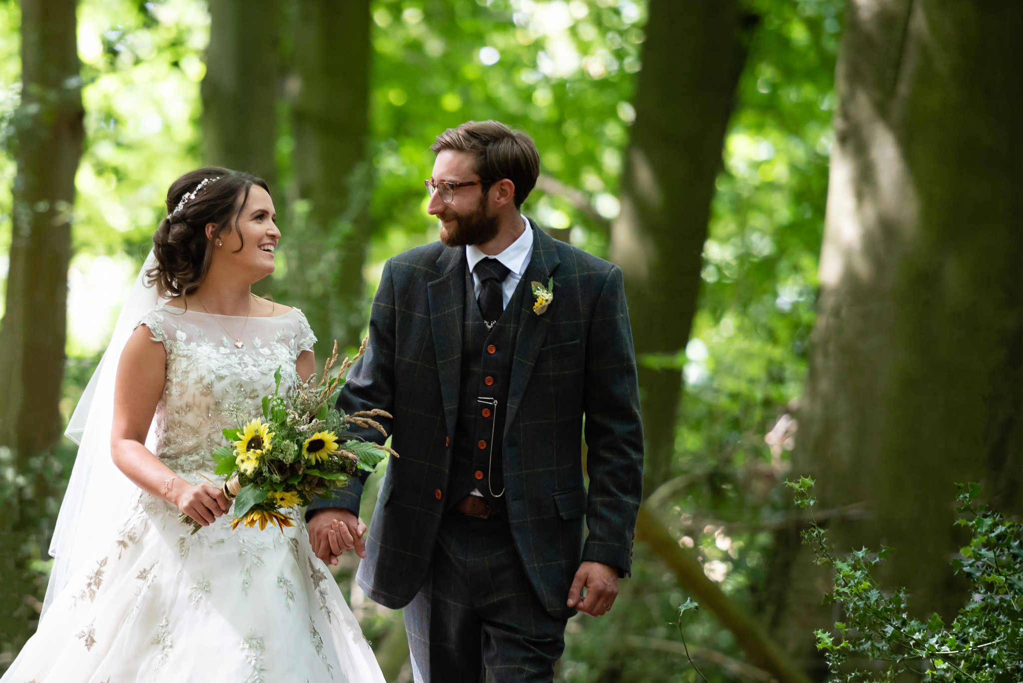 The bride and groom at their woodland wedding