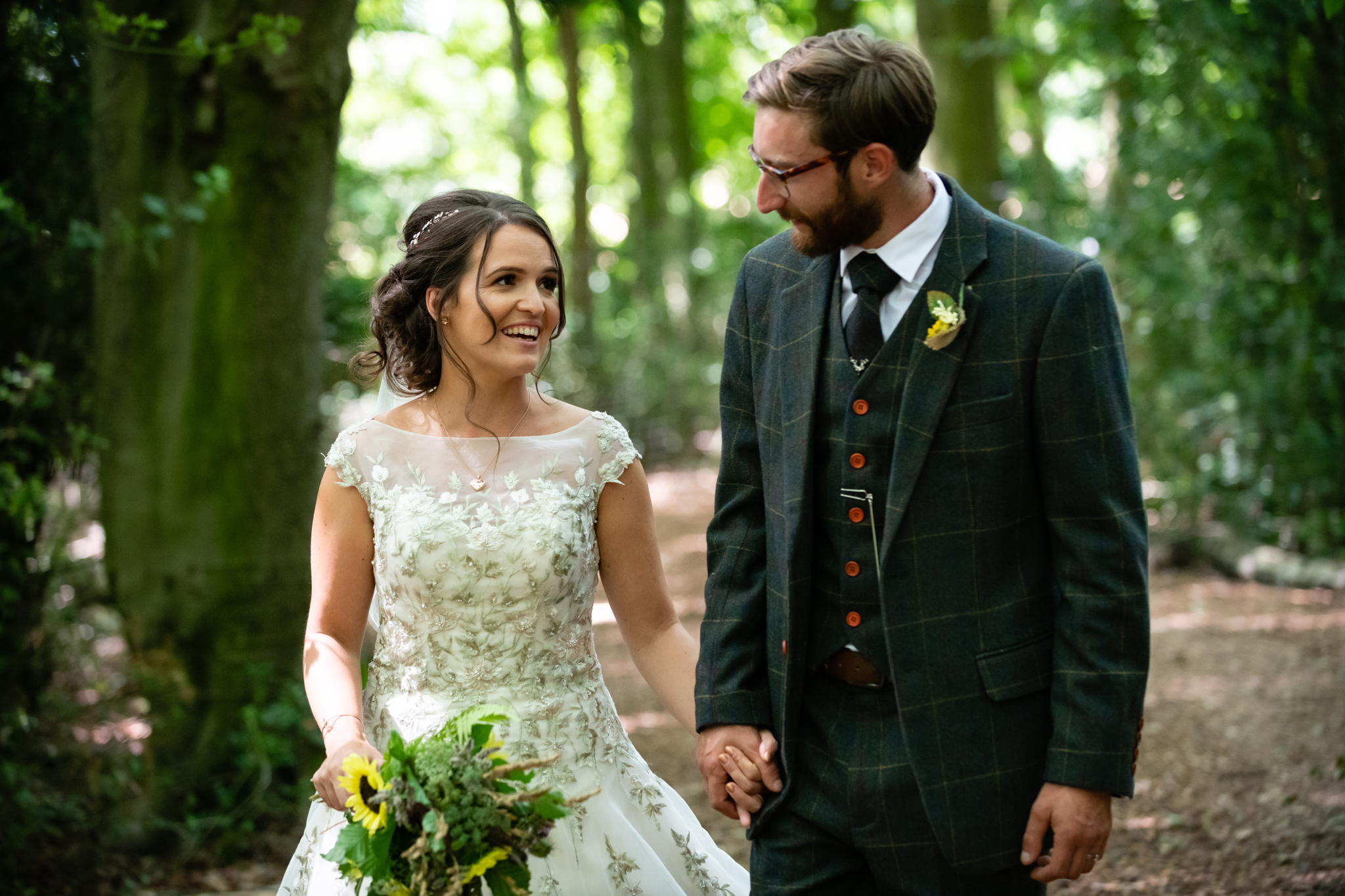 A portrait of the bride and groom at their woodland wedding