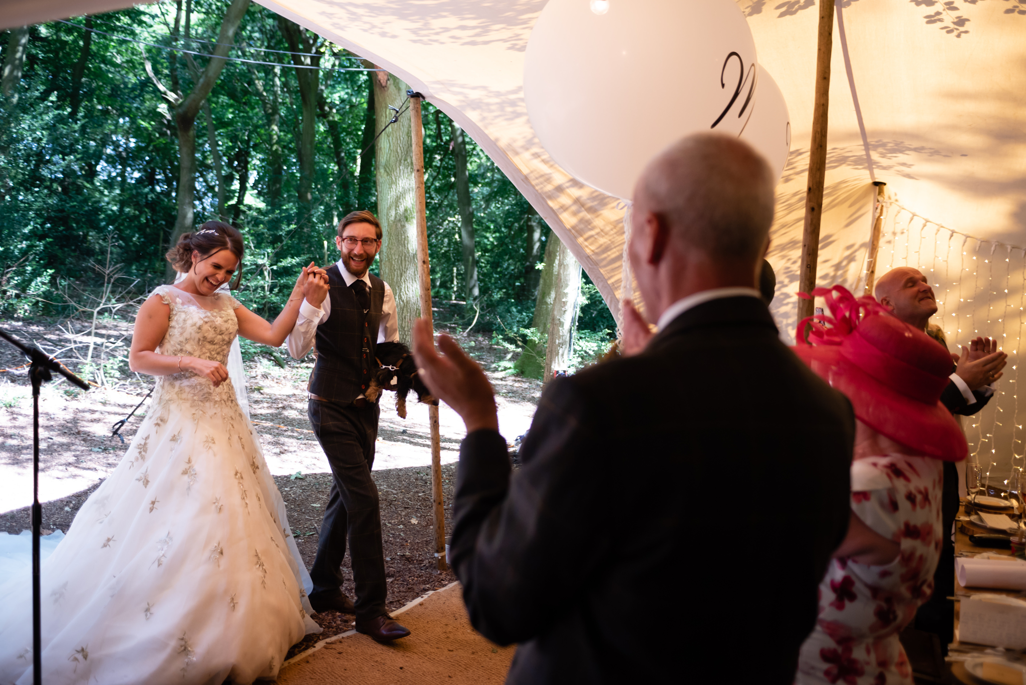 The bride and groom enter the stretched tent