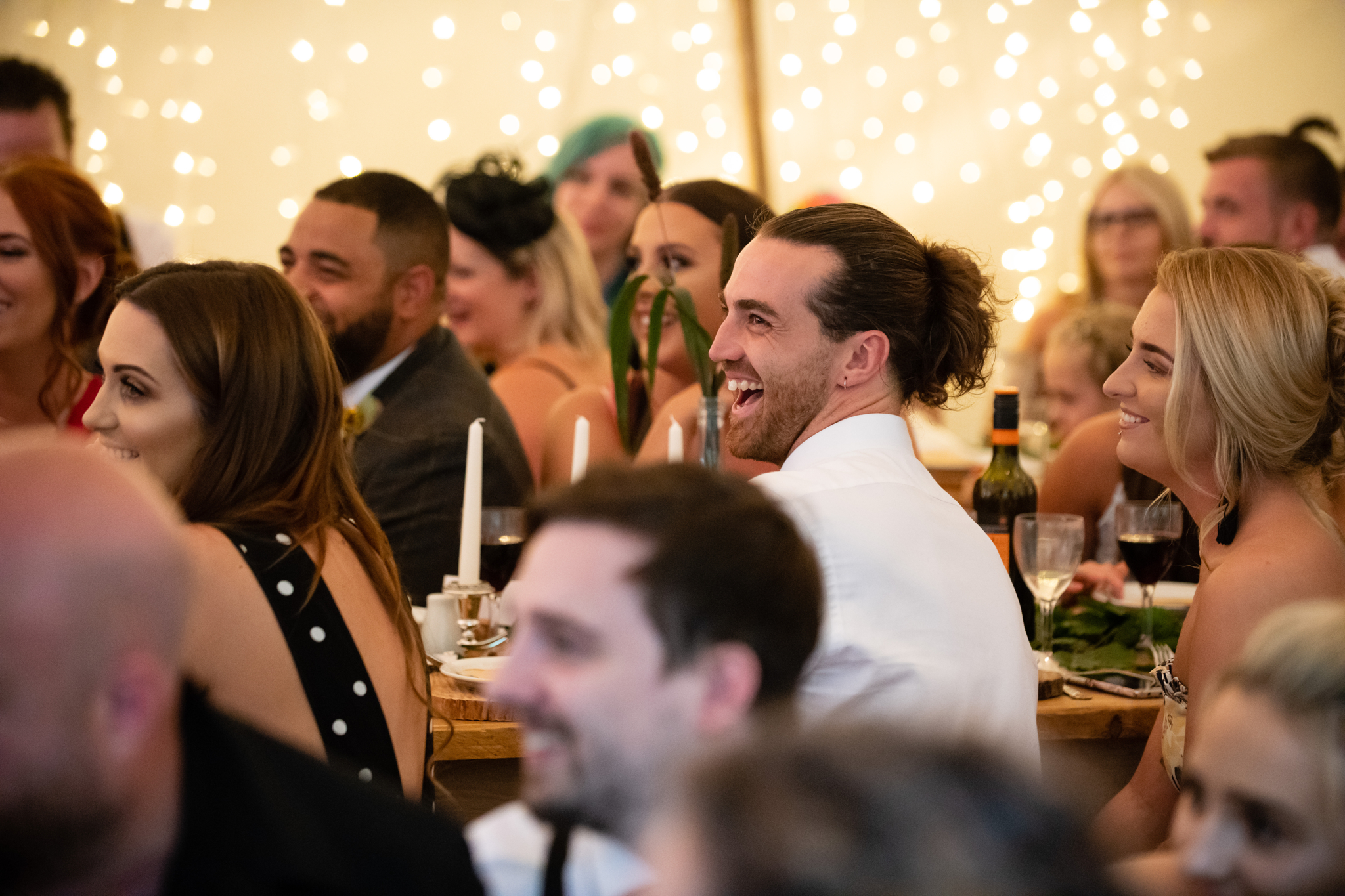 A guest laughing during the speeches