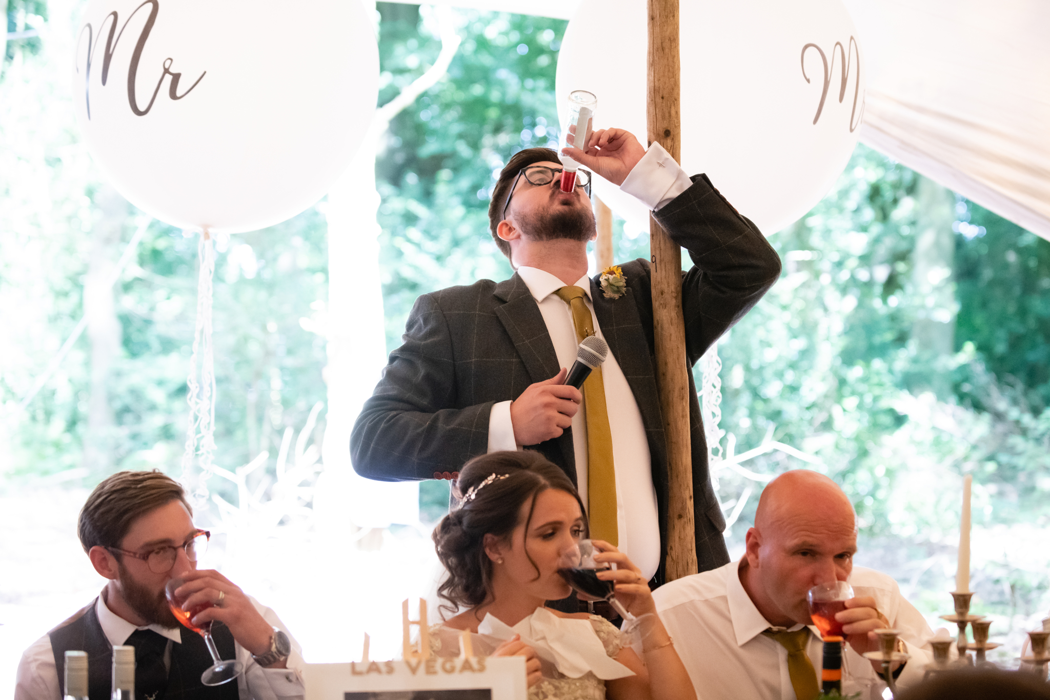 The best man down his drink at the end of his speech