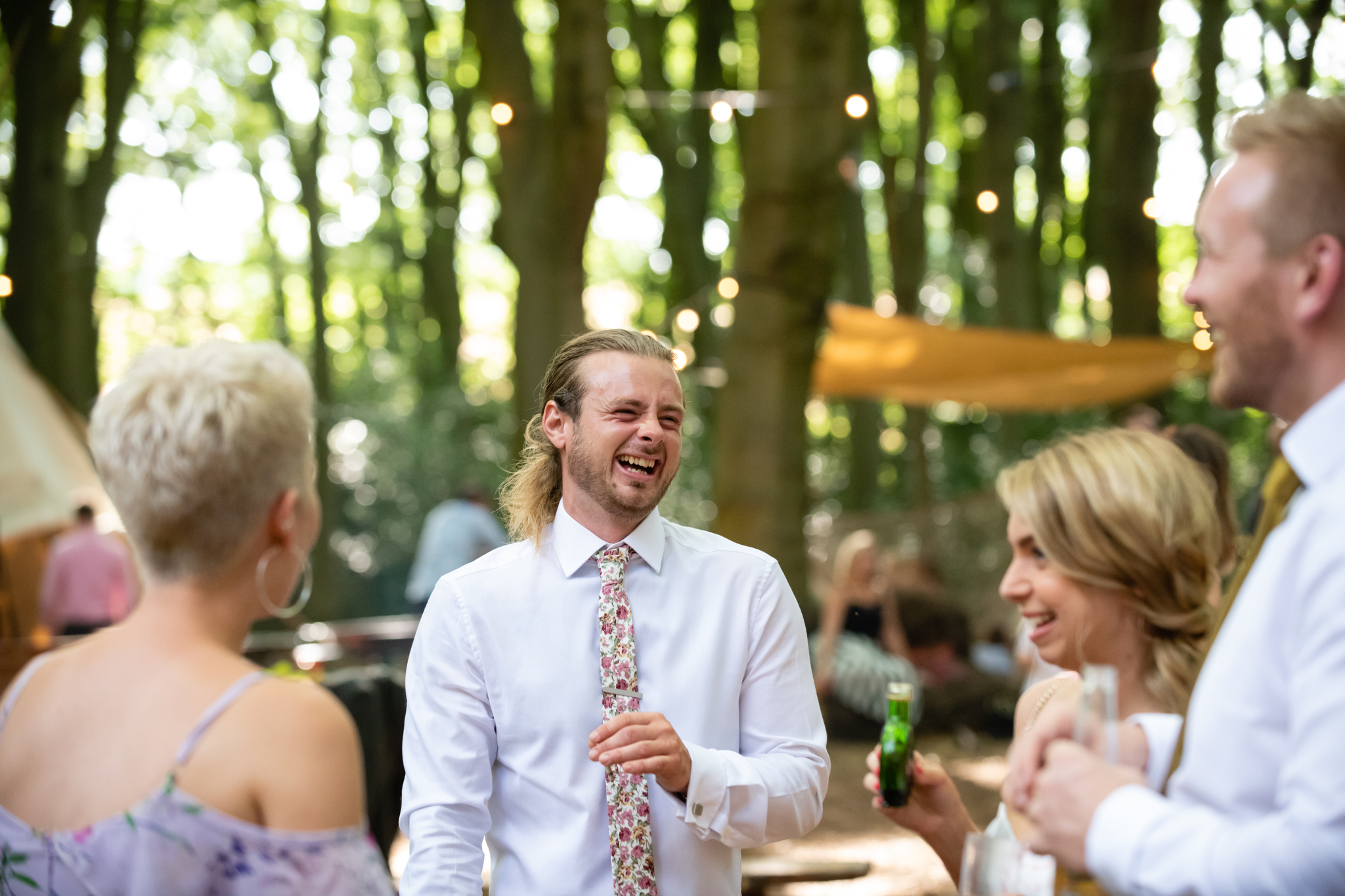 Guests laughing at woodland Weddings