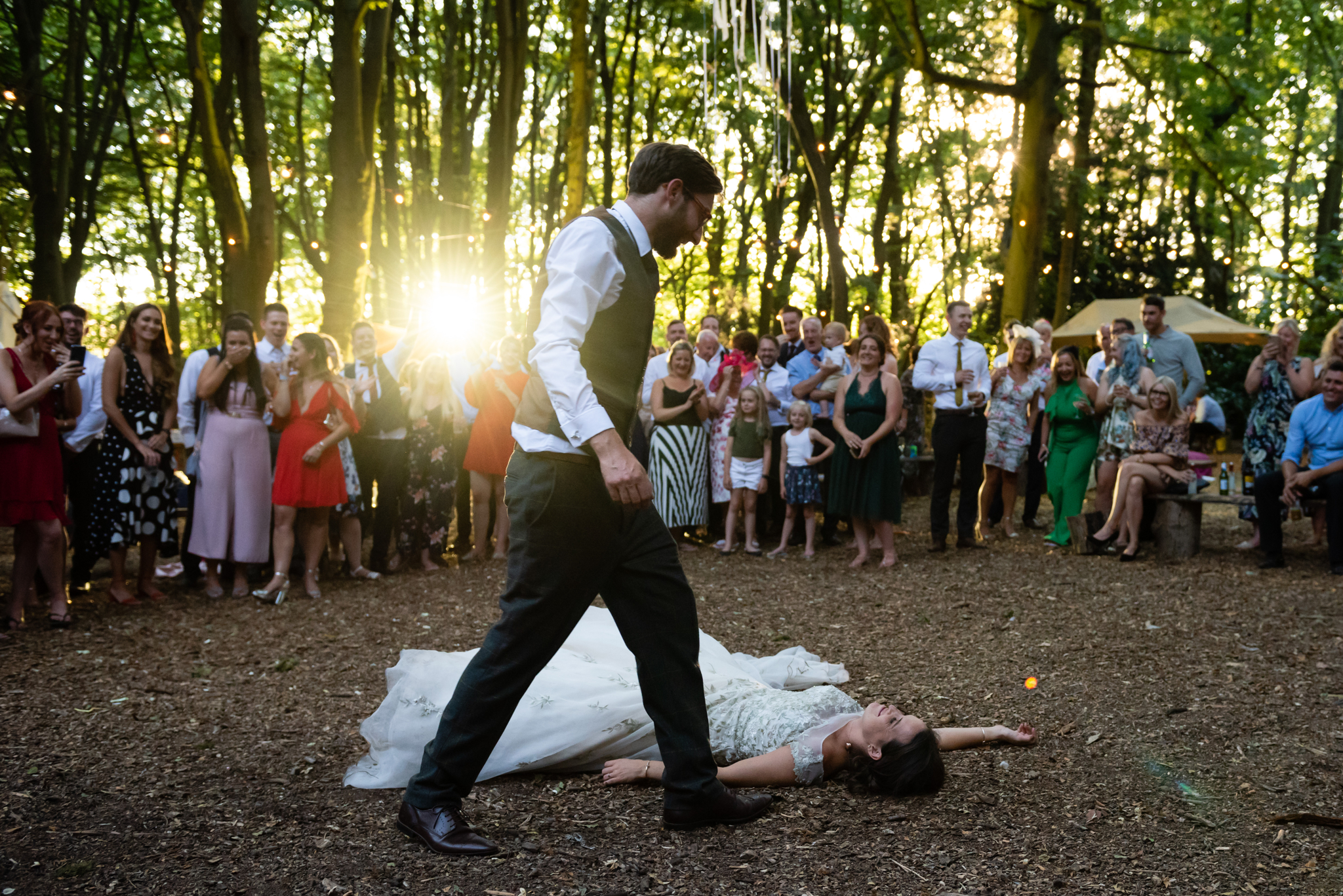 The bride trips over during the first dance at Woodland Weddings