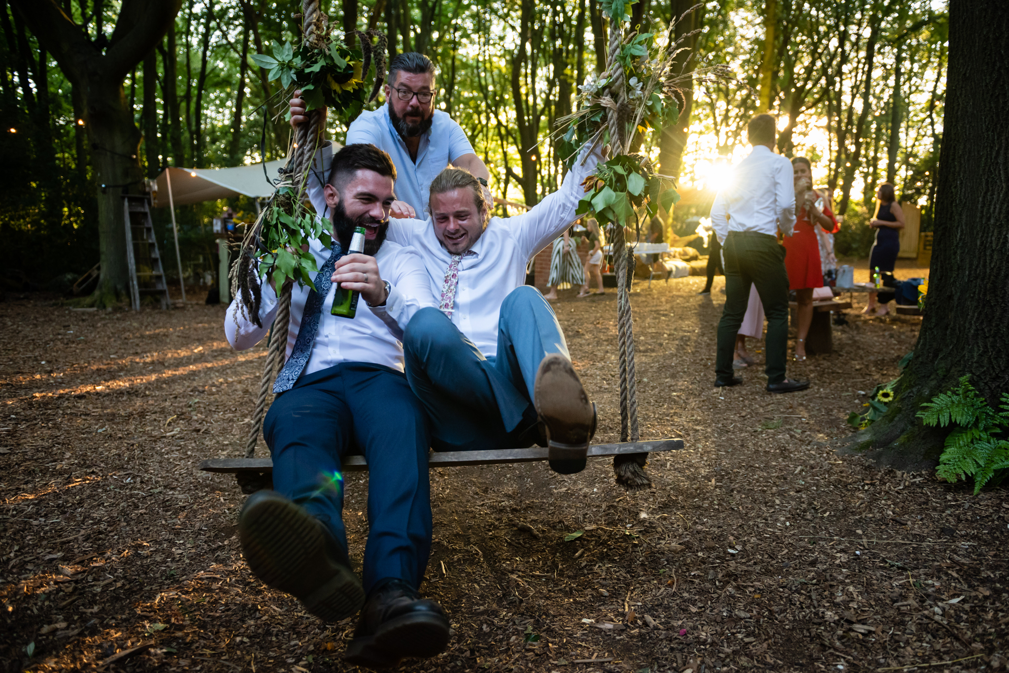 Guests playing on the swing at Woodland Weddings
