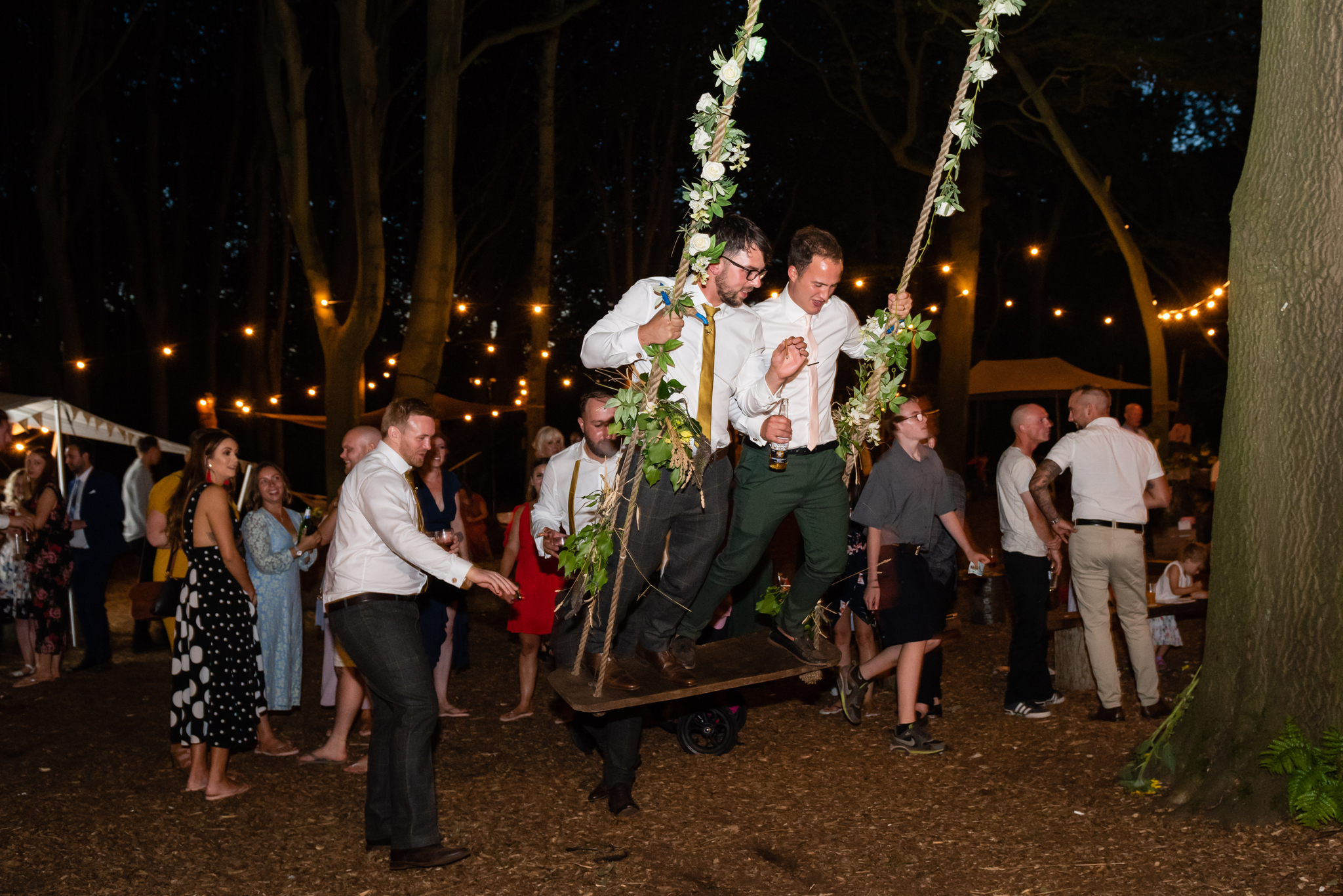 Fun on the swing at the Woodland wedding in Tring