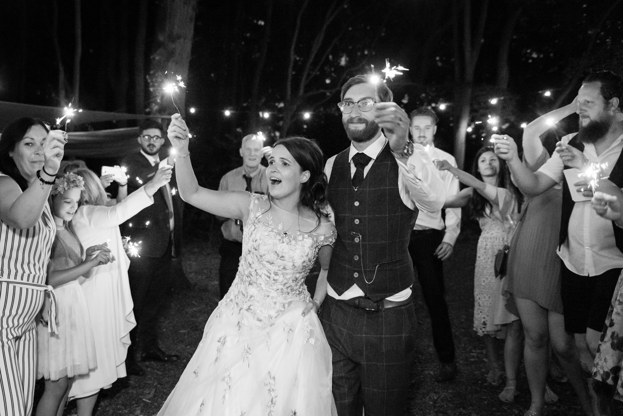 Sparklers at a woodland wedding